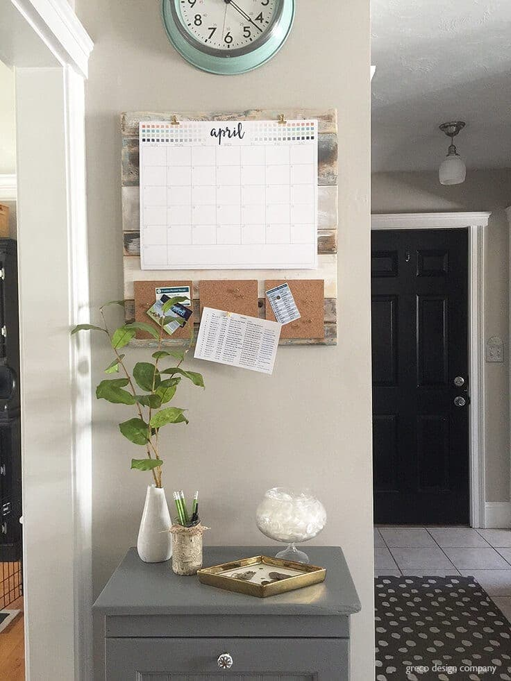 DIY shiplap command center on wall with cork pinboards and calendar