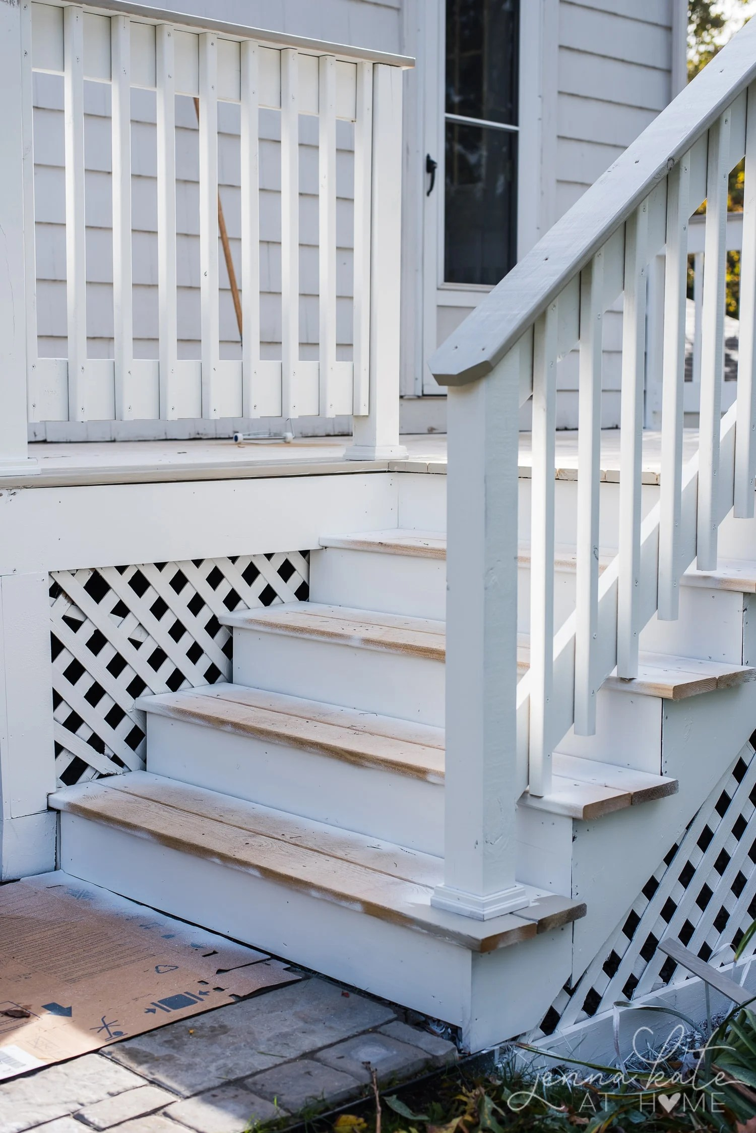 Spraying the deck white with a paint sprayer