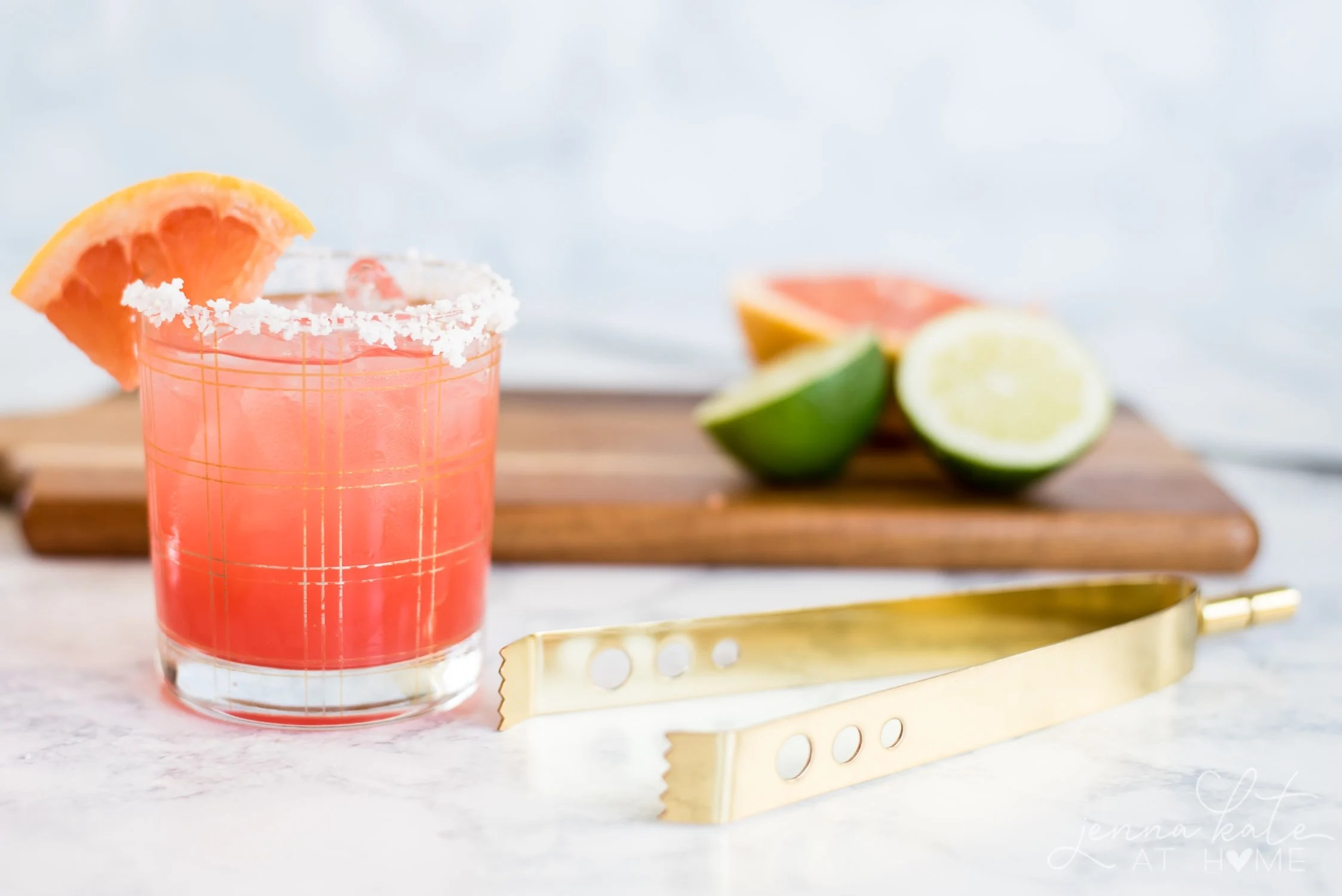 shot of the grapefruit cocktail with an ice tongs