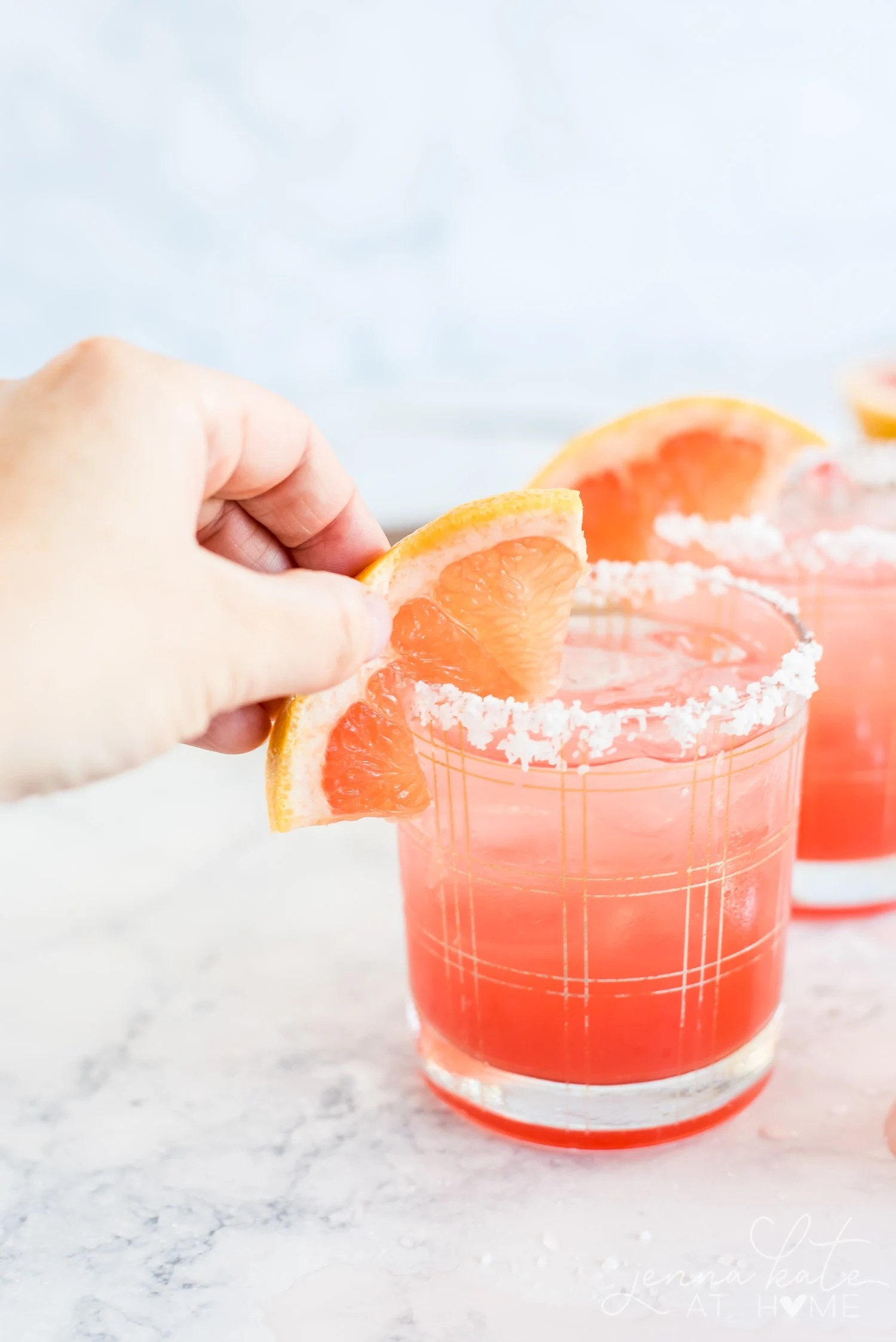Garnishing the glass with a wedge of grapefruit