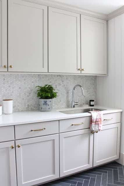 Laundry room cabinets painted Sherwin Williams Agreeable Gray