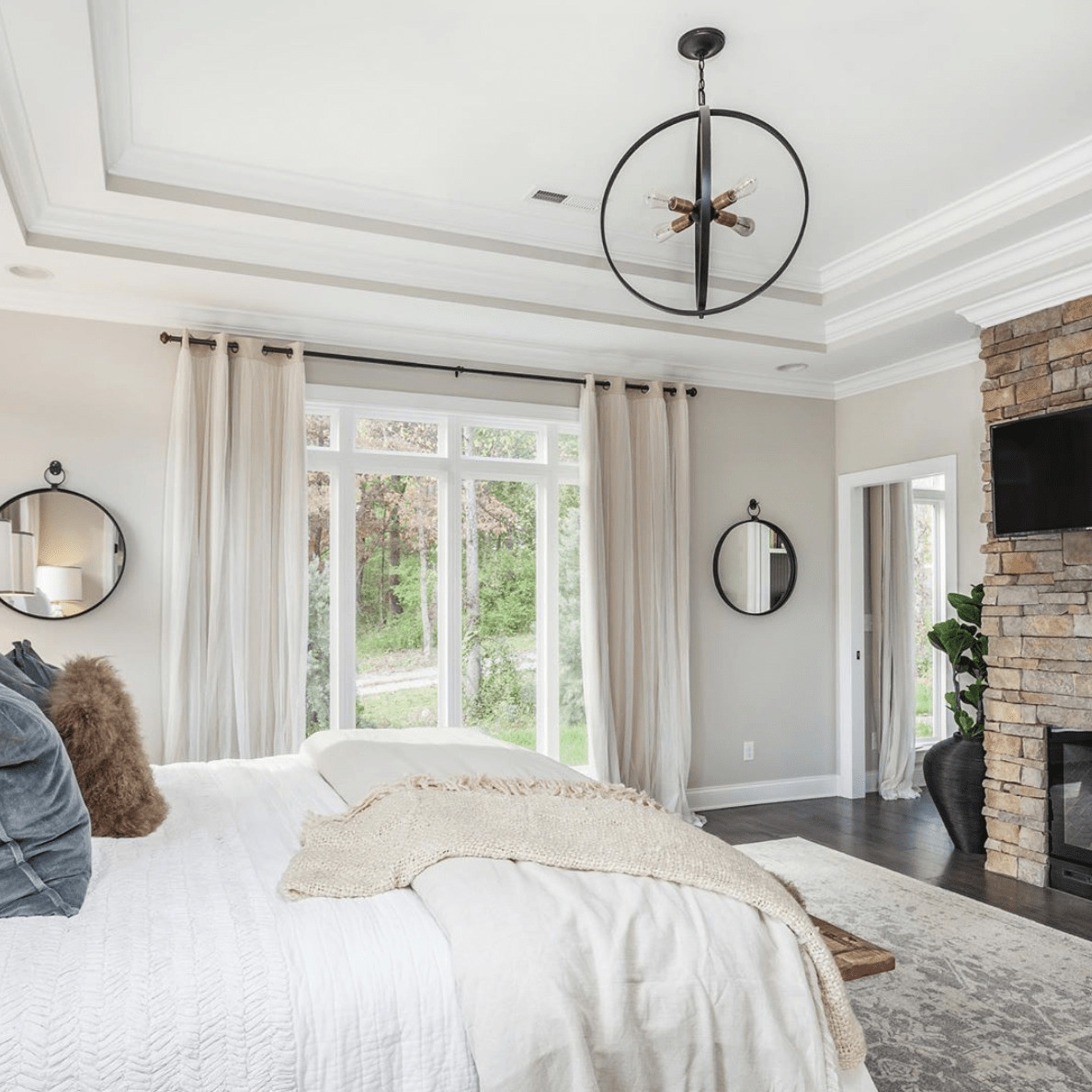 Master bedroom that shows the warm undertones of agreeable gray paint color on the walls