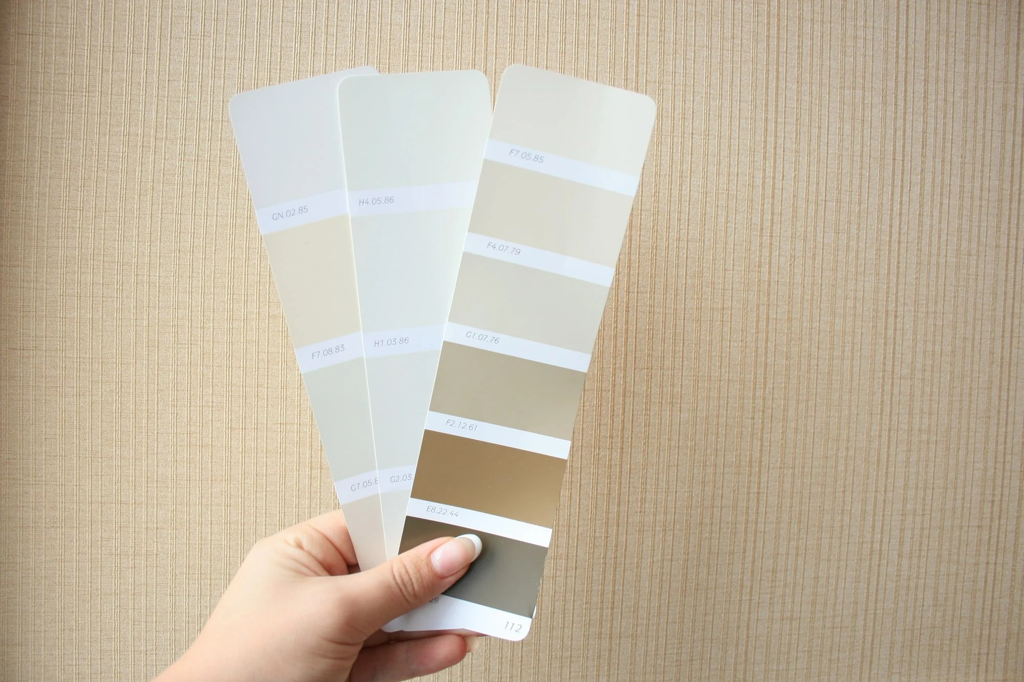 Paint chips to help pick a color scheme when decorating the living room