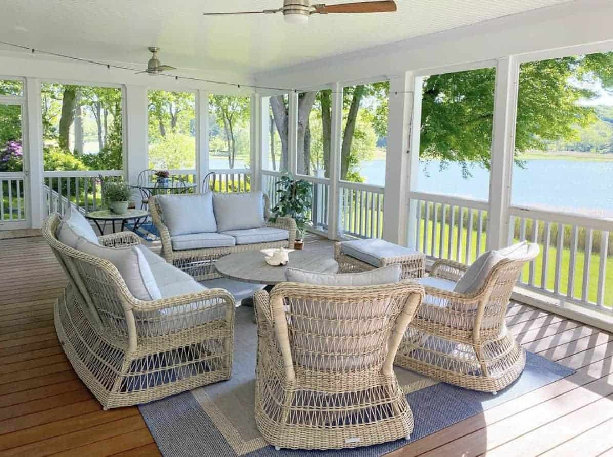 Traditional style sunroom overlooking a lake