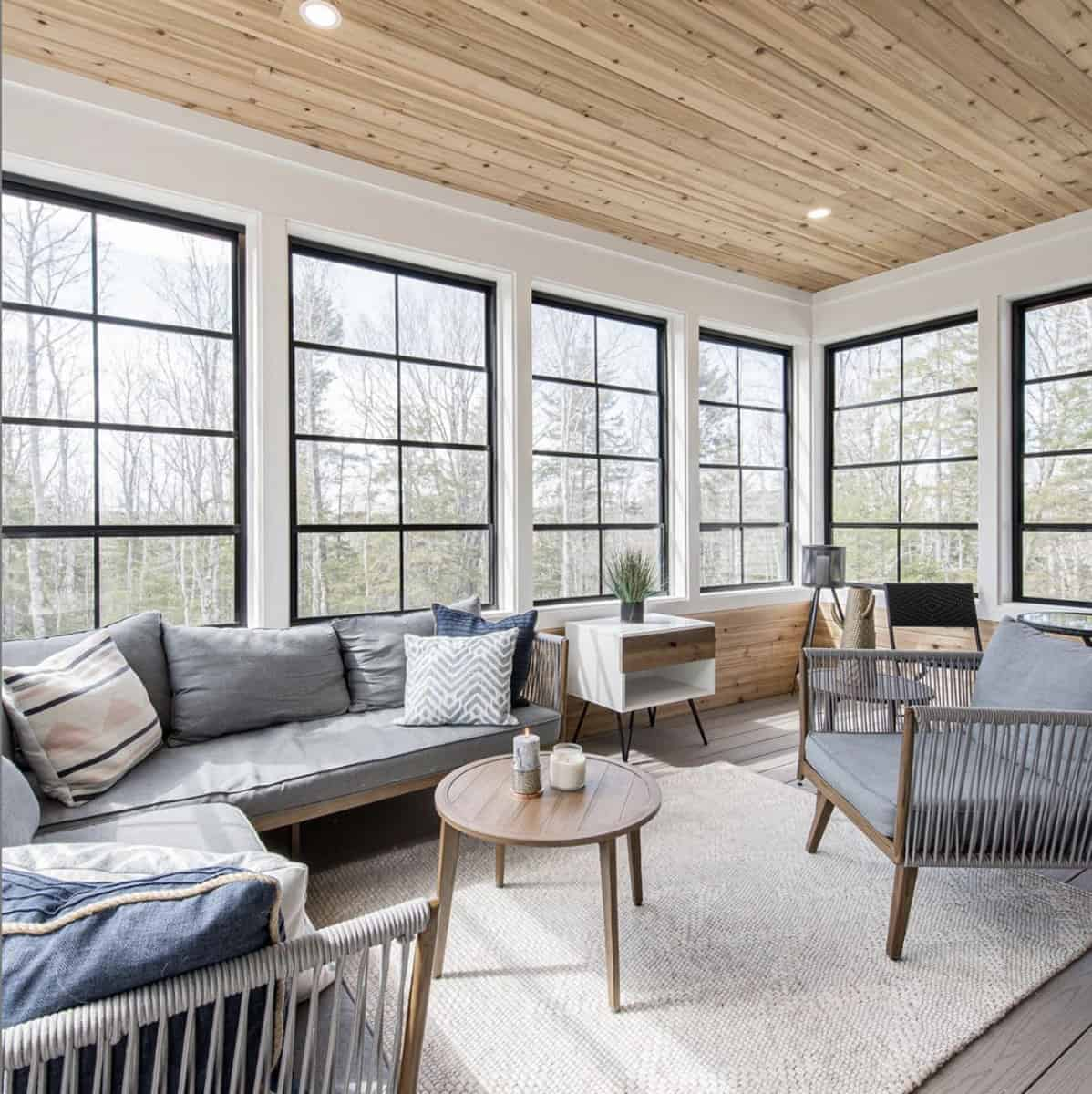 Beautiful porch with wood planked ceilings and black framed windows