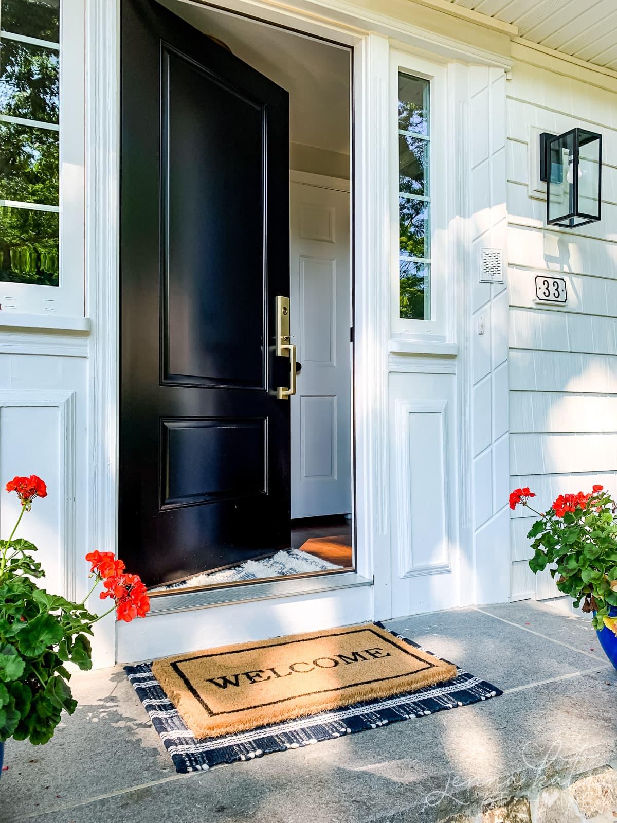 Welcome door mat at the front door to wipe feet off before entering the house