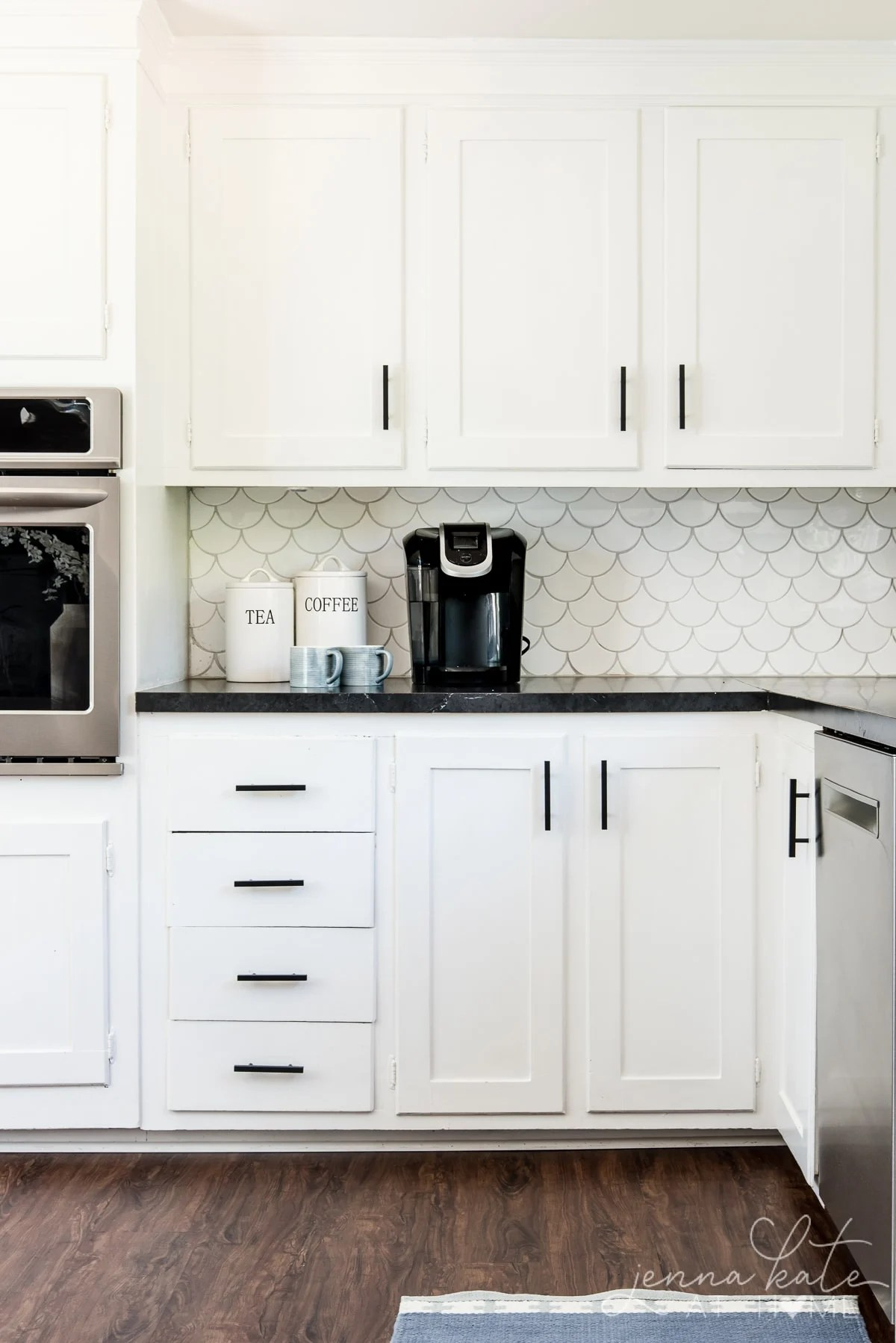 Matte black kitchen pulls on white shaker cabinets