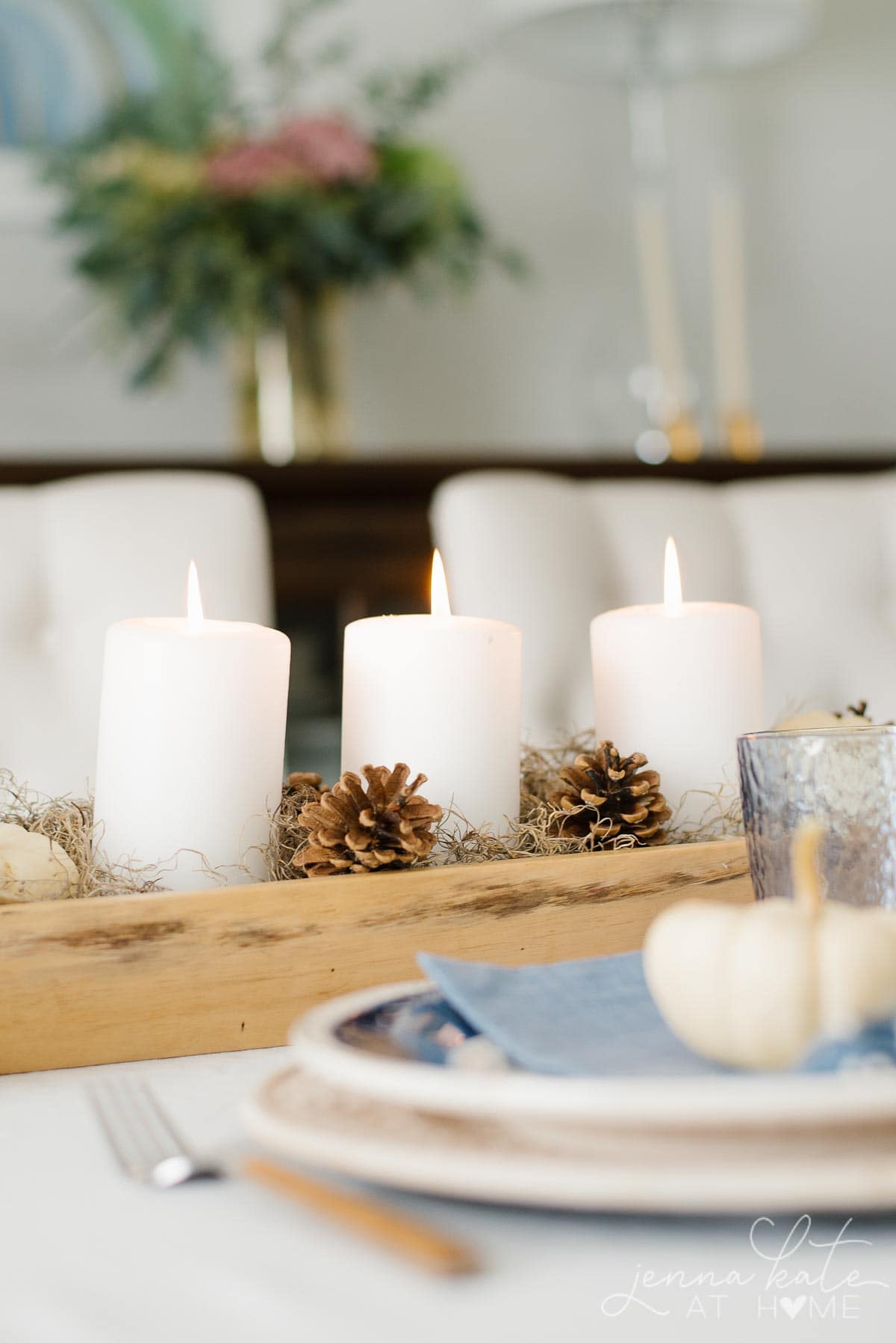 Candles, moss and pinecones for a natural looking fall centerpiece
