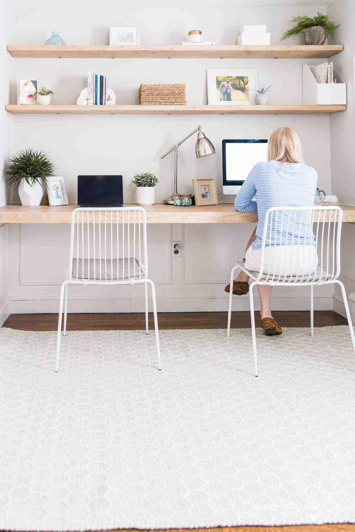 Work from home office space with DIY desk and floating shelves