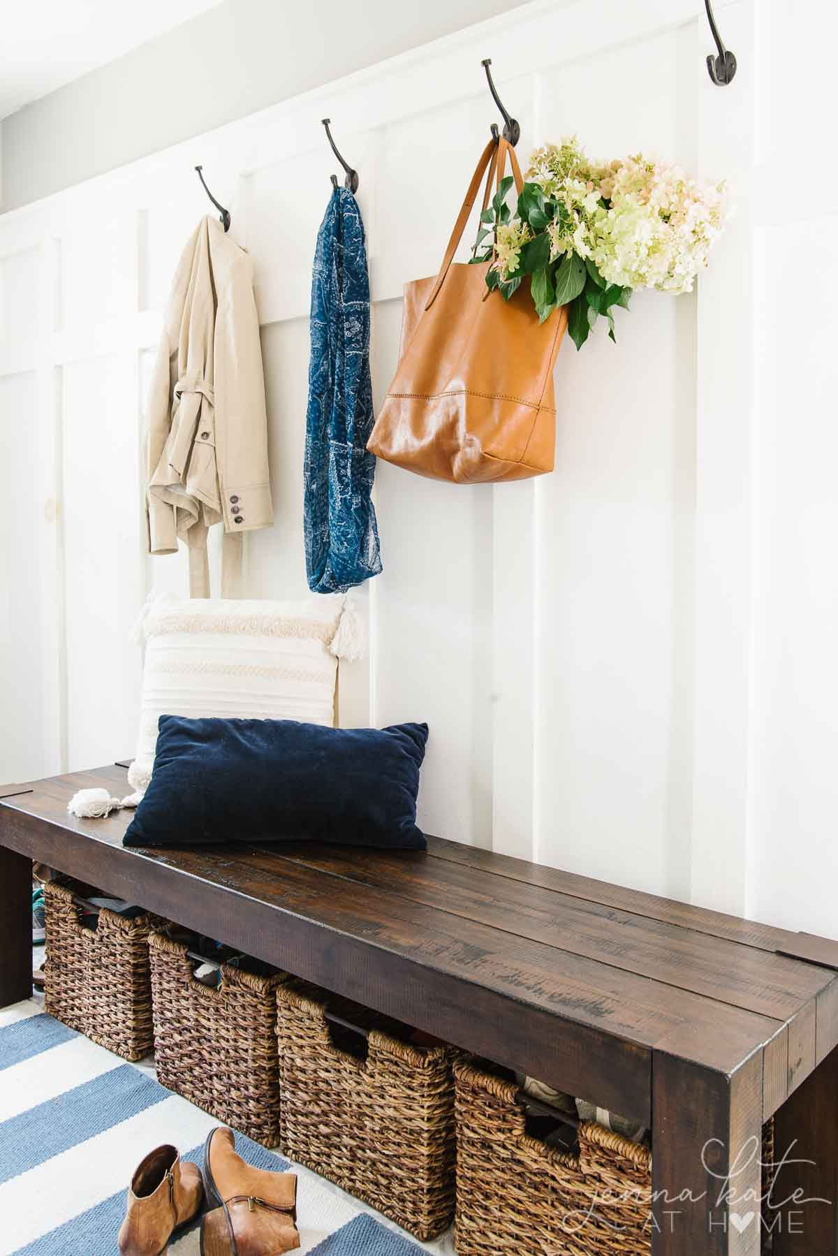 Mudroom simply decorated for fall with a tote bag filled with hydrangeas