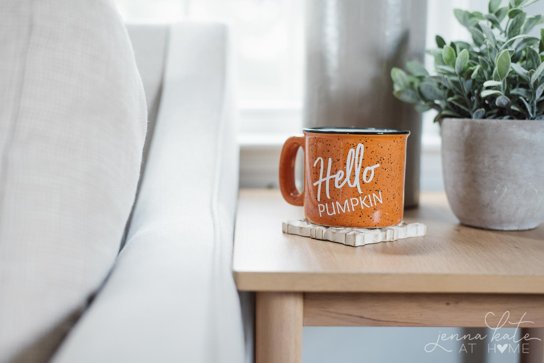 Hello pumpkin fall mug on the coffee table
