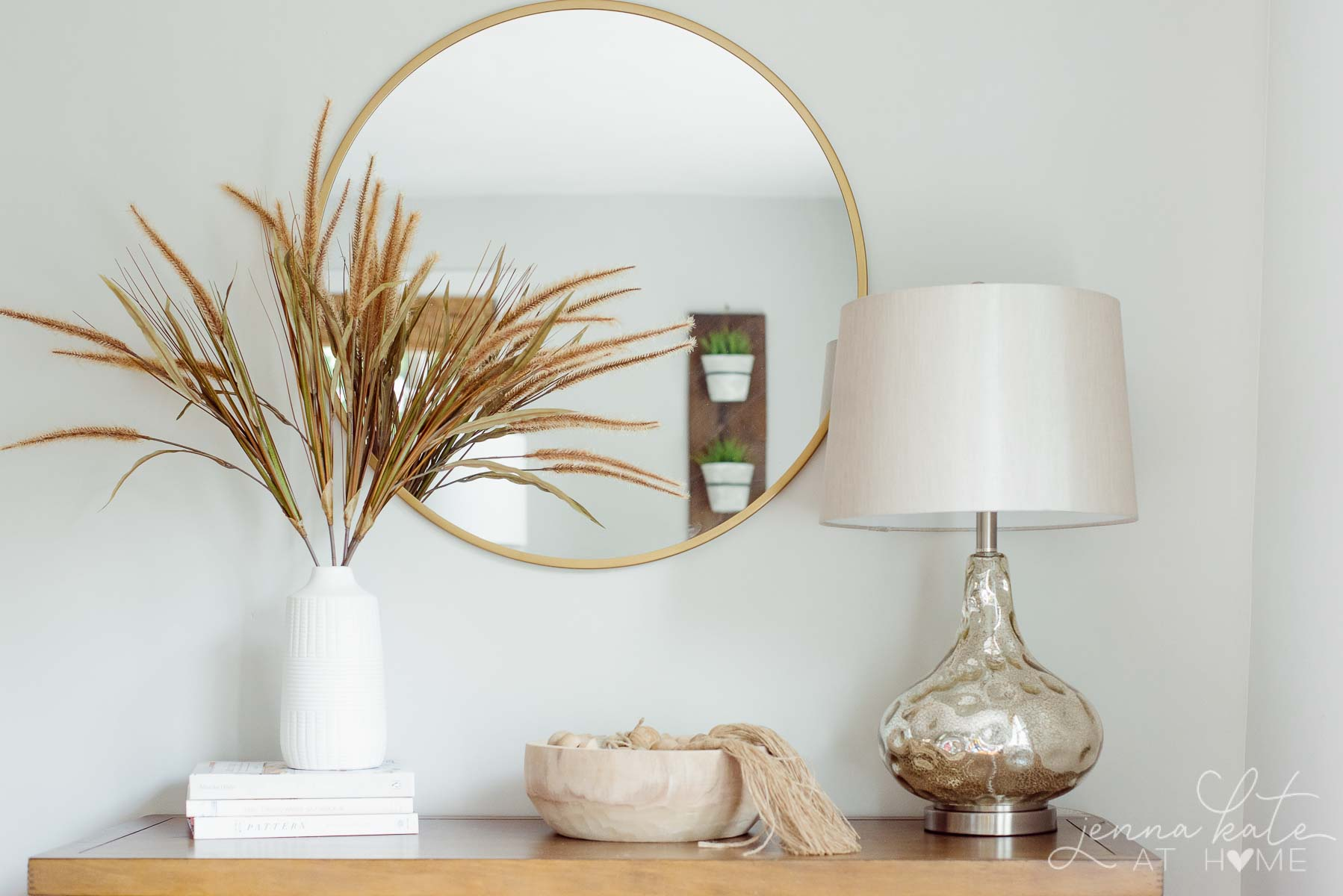 Living room console table with fall grasses in a vase
