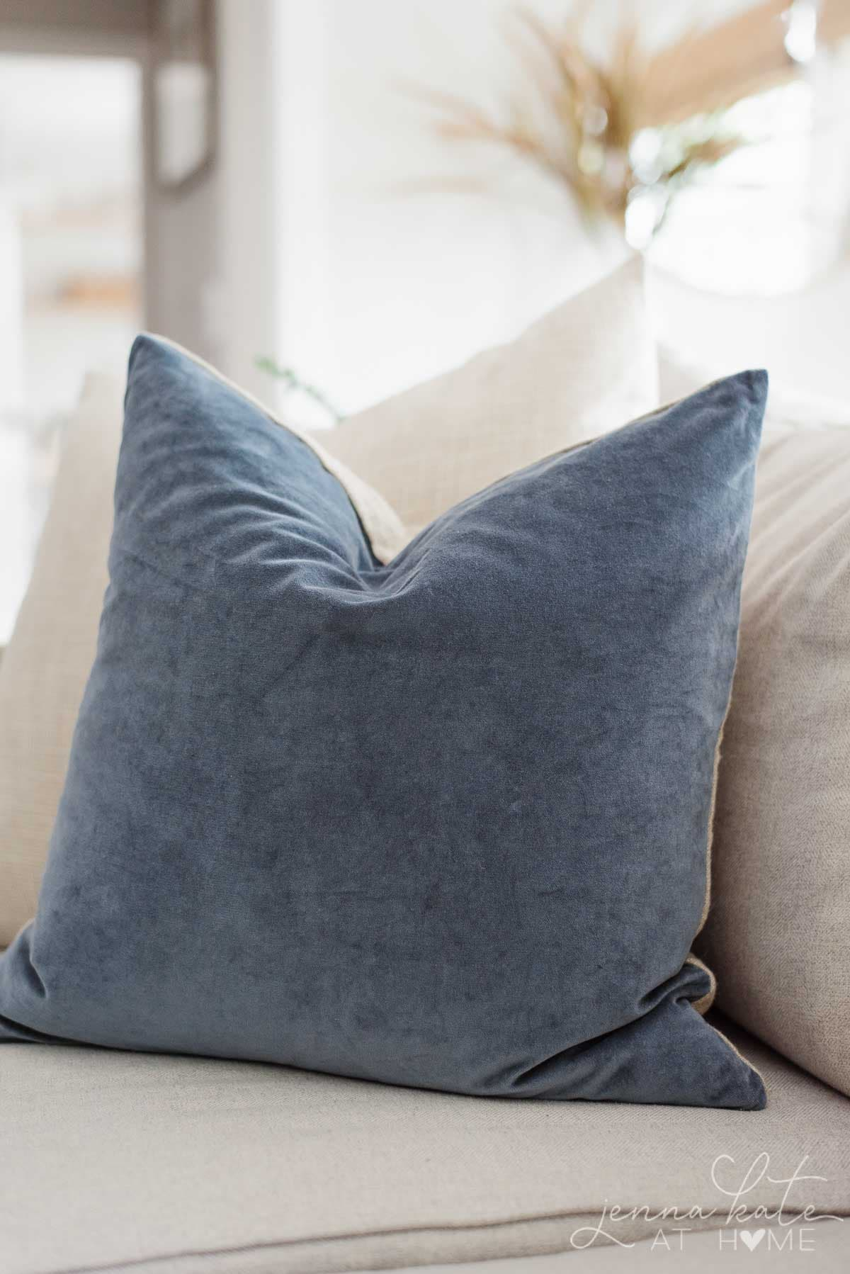 Buy throw pillow covers with the inserts because they are easy to store