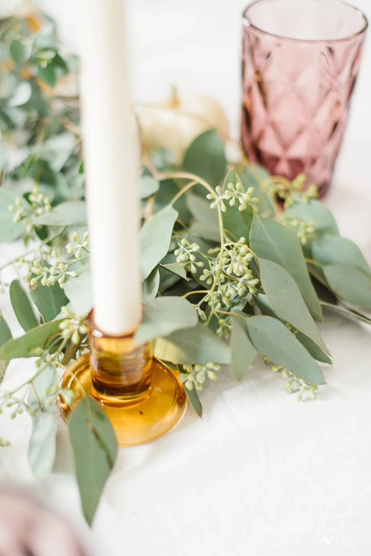 Seeded eucalyptus is the perfect table runner for a fall tablescape