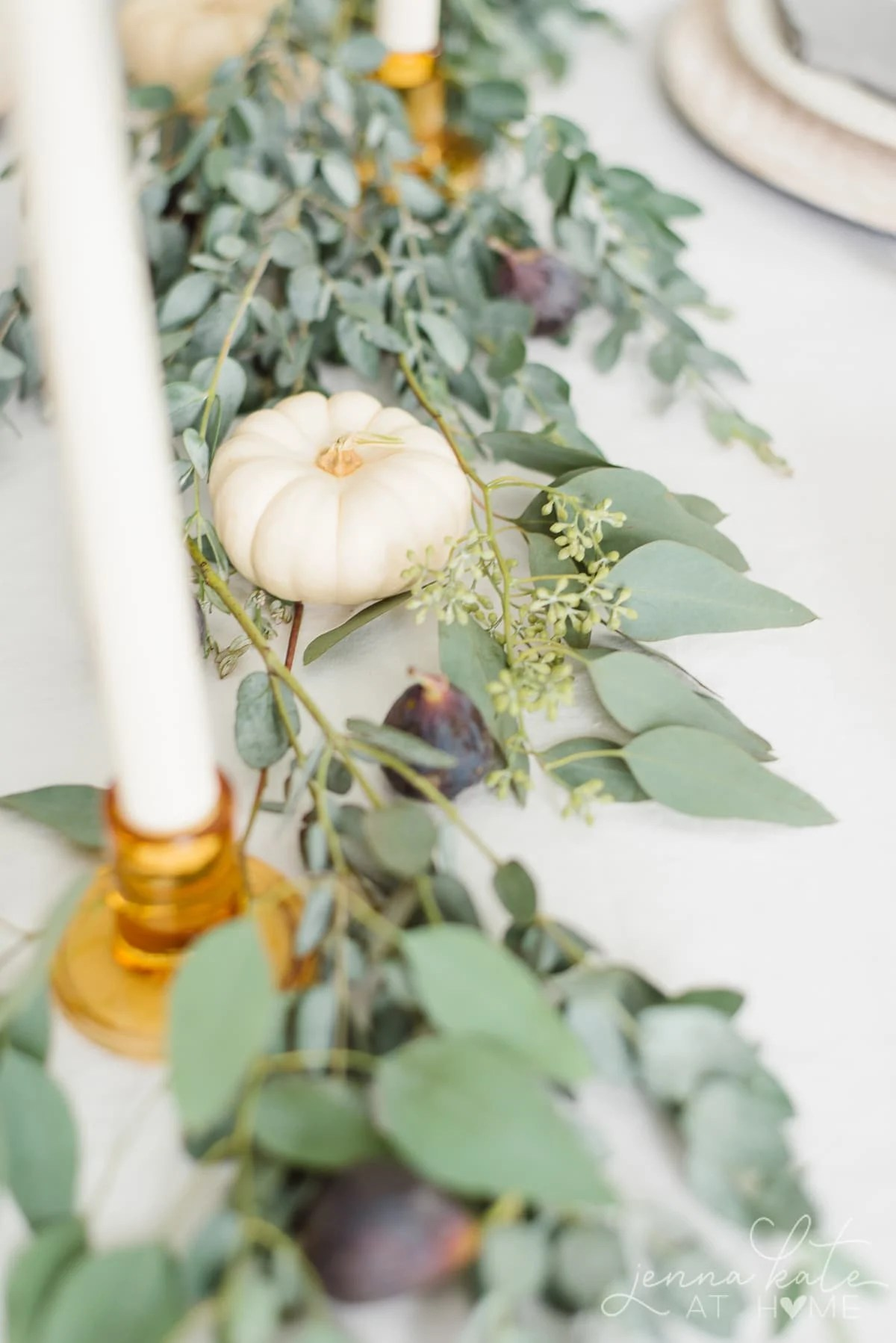 Miniature white pumpkins, eucalyptus and figs for the jewel toned tablescape