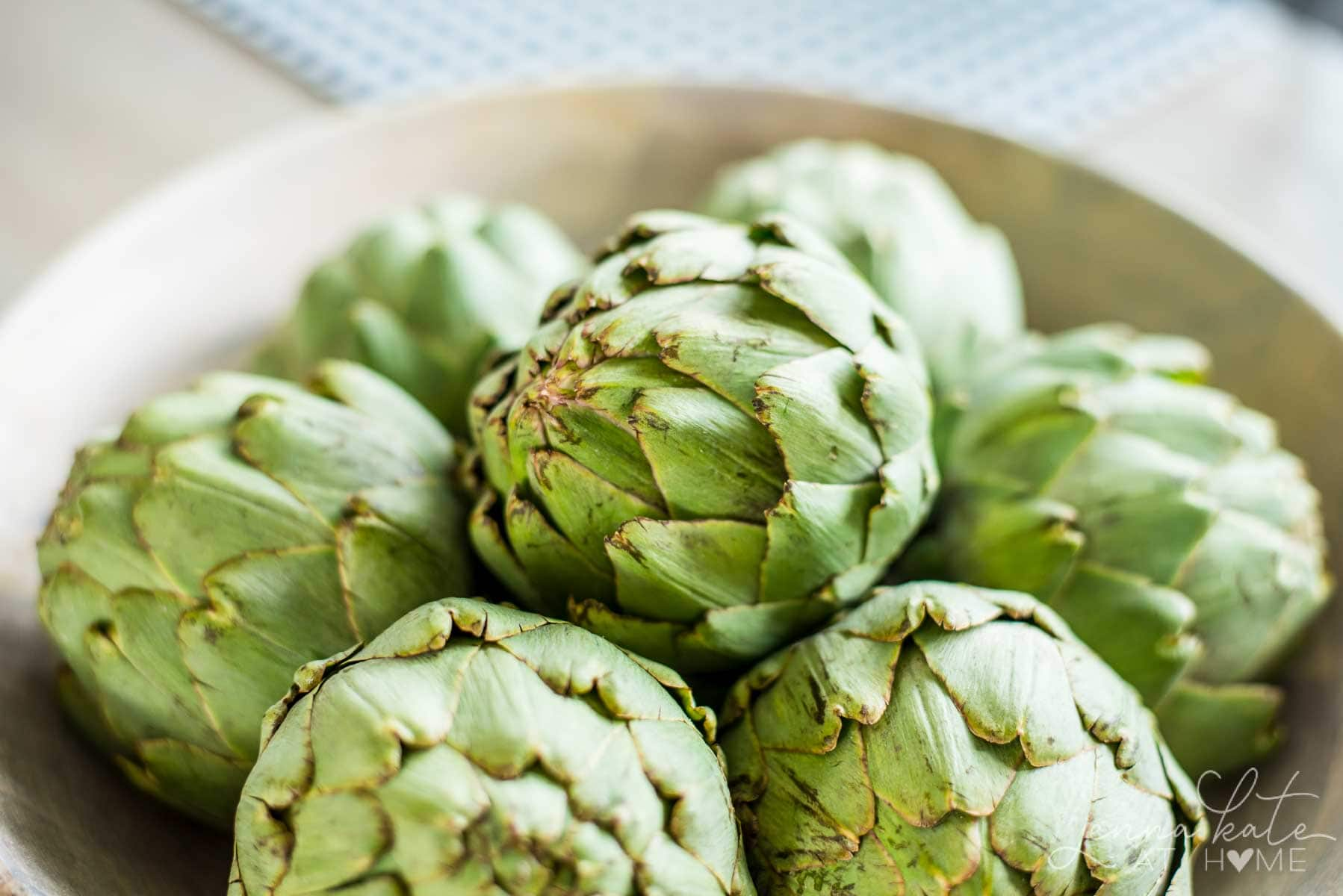 A bowl of artichokes or any other fruit or vegetable is a simple natural fall decorating idea.