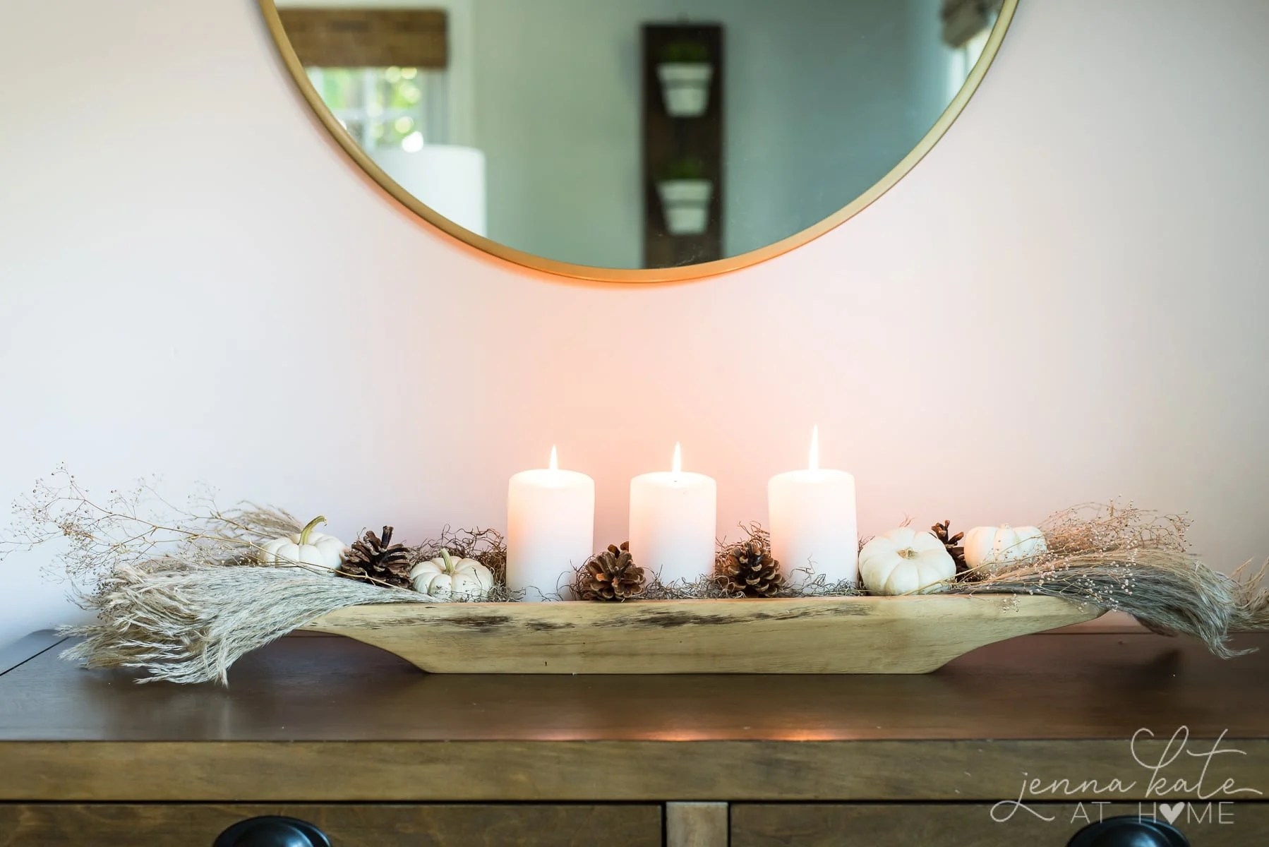 Centerpiece under a mirror on a living room console table
