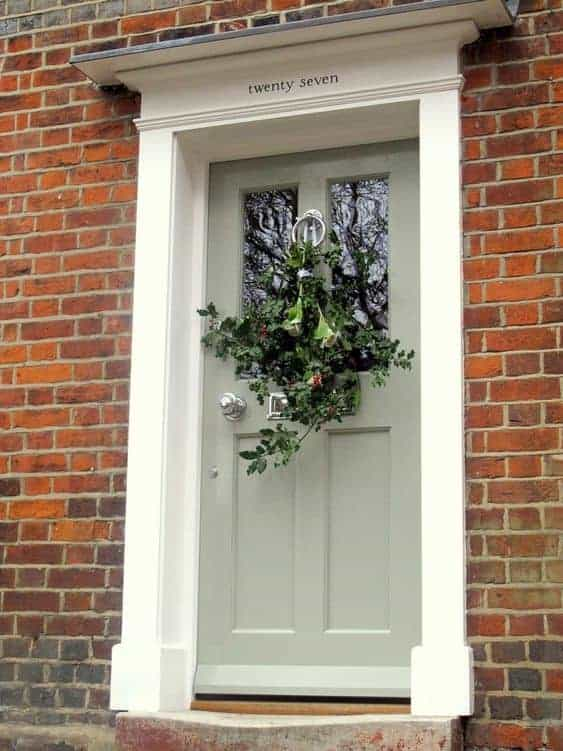 sage green front door color red brick house
