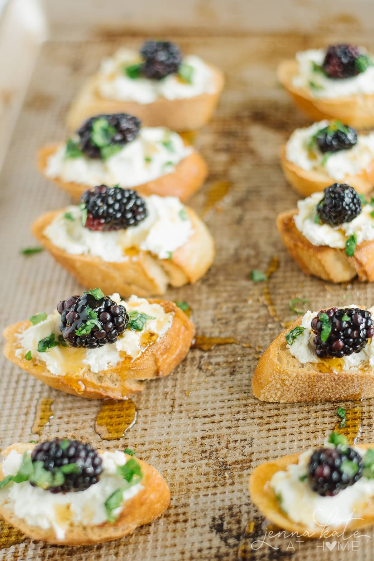 Honey drizzled over crostini appetizers