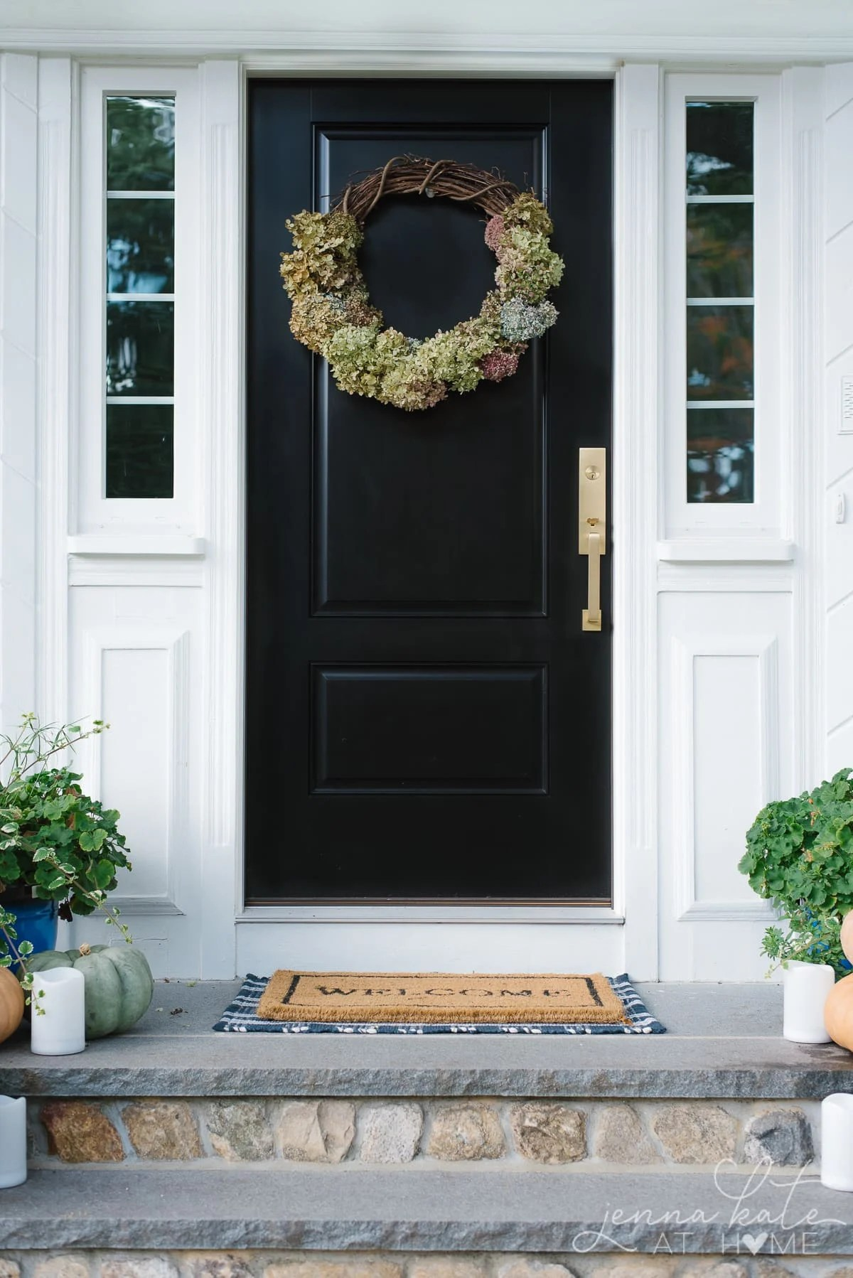 Hydrangea wreath hanging on the front door for fall decor