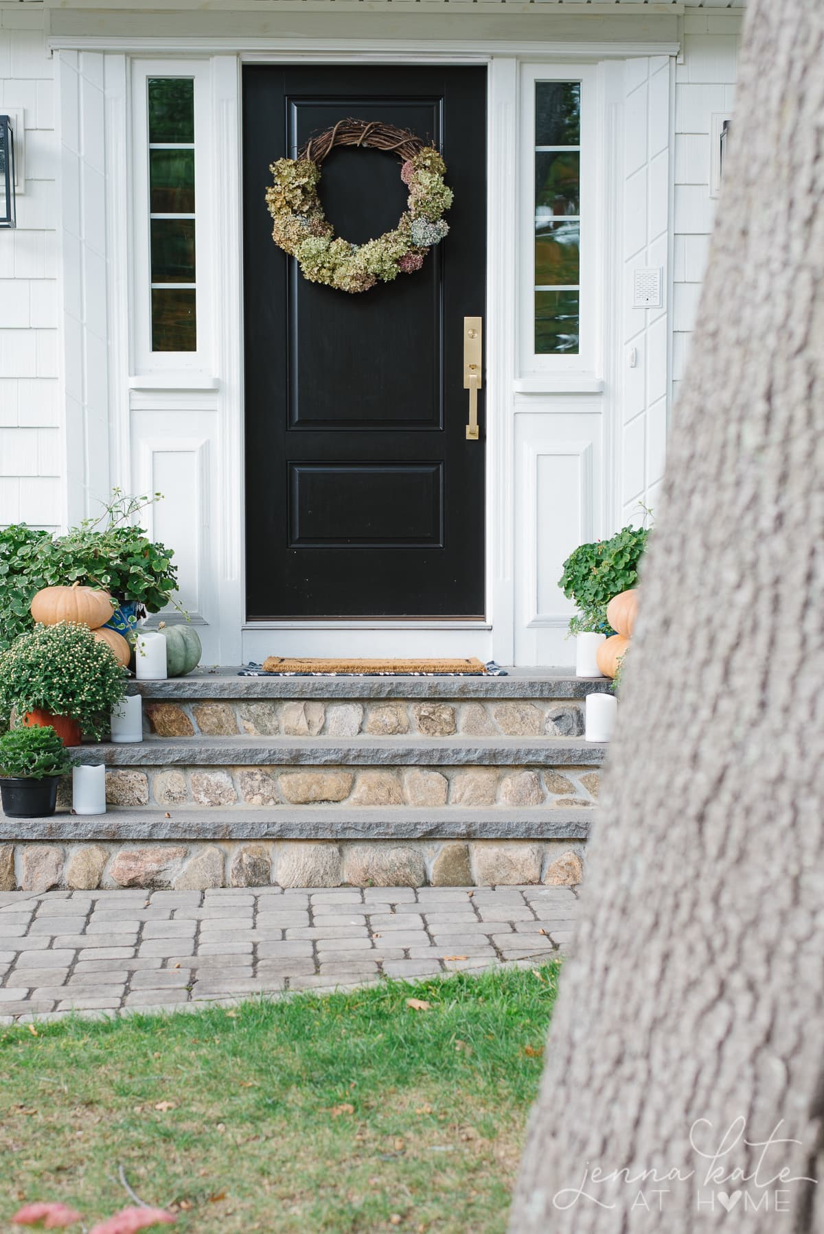 Fall front porch with DIY hydrangea wreath