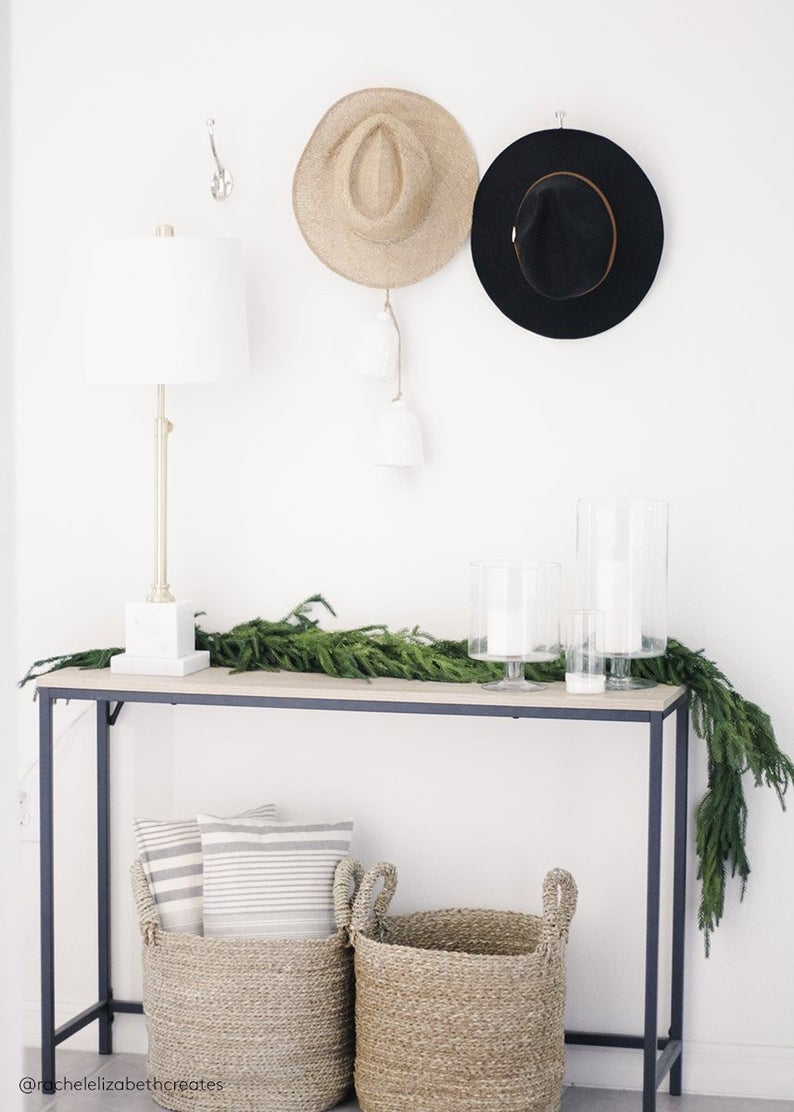 Simple realistic looking pine garland draped across a table