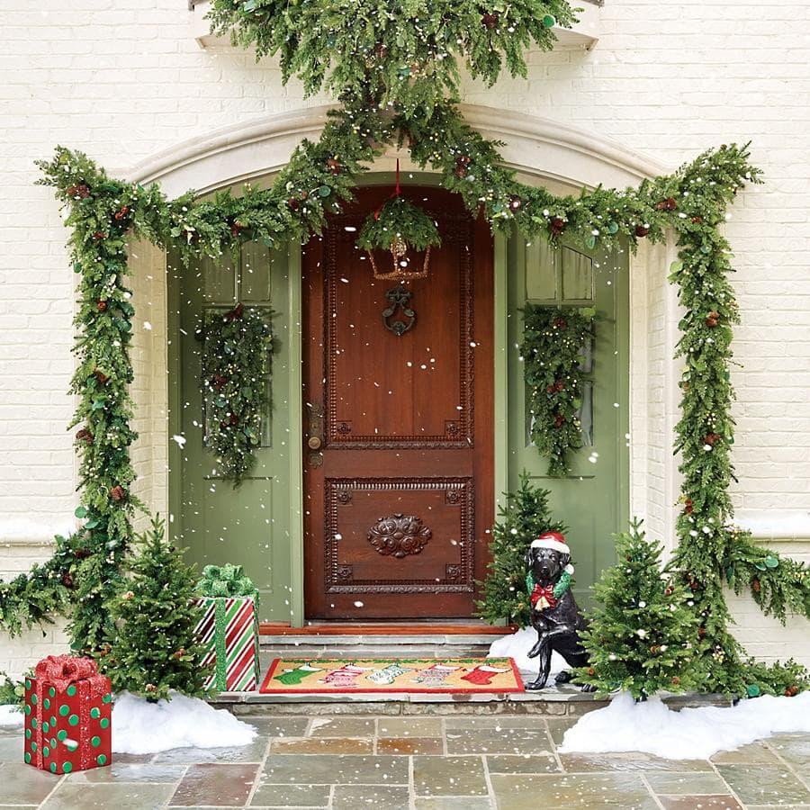 Front entryway with garlands hanging around the door