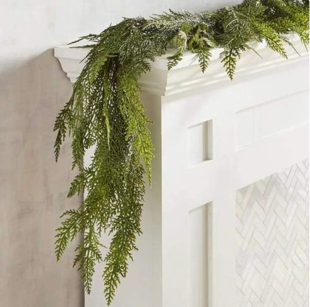 Cedar garland hanging over the side of a mantel