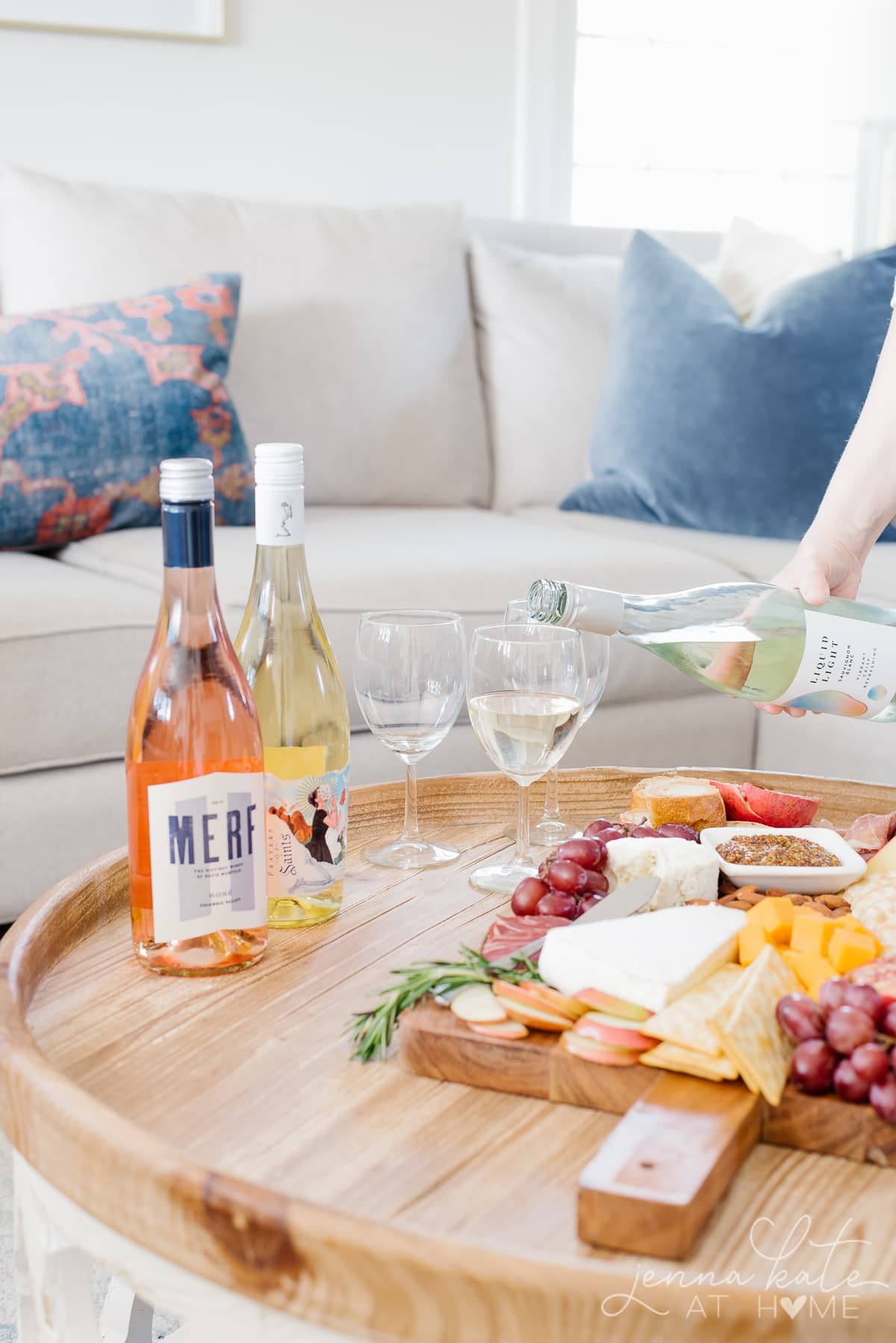 Wine tasting party with different wines and a cheese and meat charcuterie board