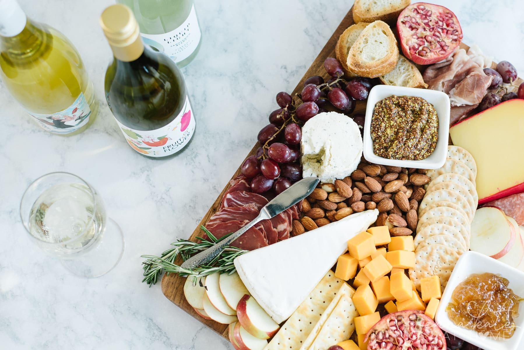 Bottles of wine served alongside cheese