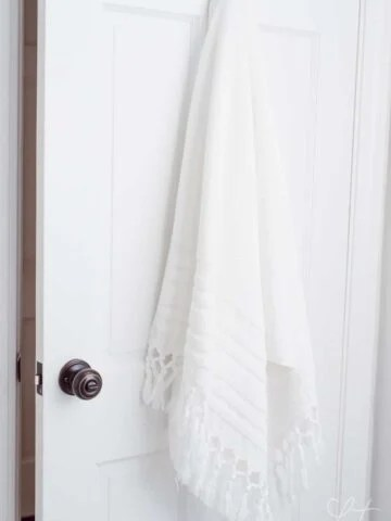 towel hanging on hook in bathroom