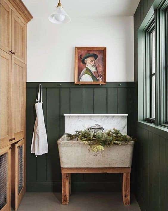 Wainscoting in laundry room painted Benjamin Moore Backwoods, a dark hunter green