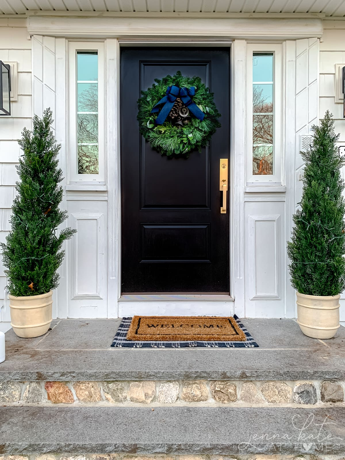 Black front door with Christmas wreath