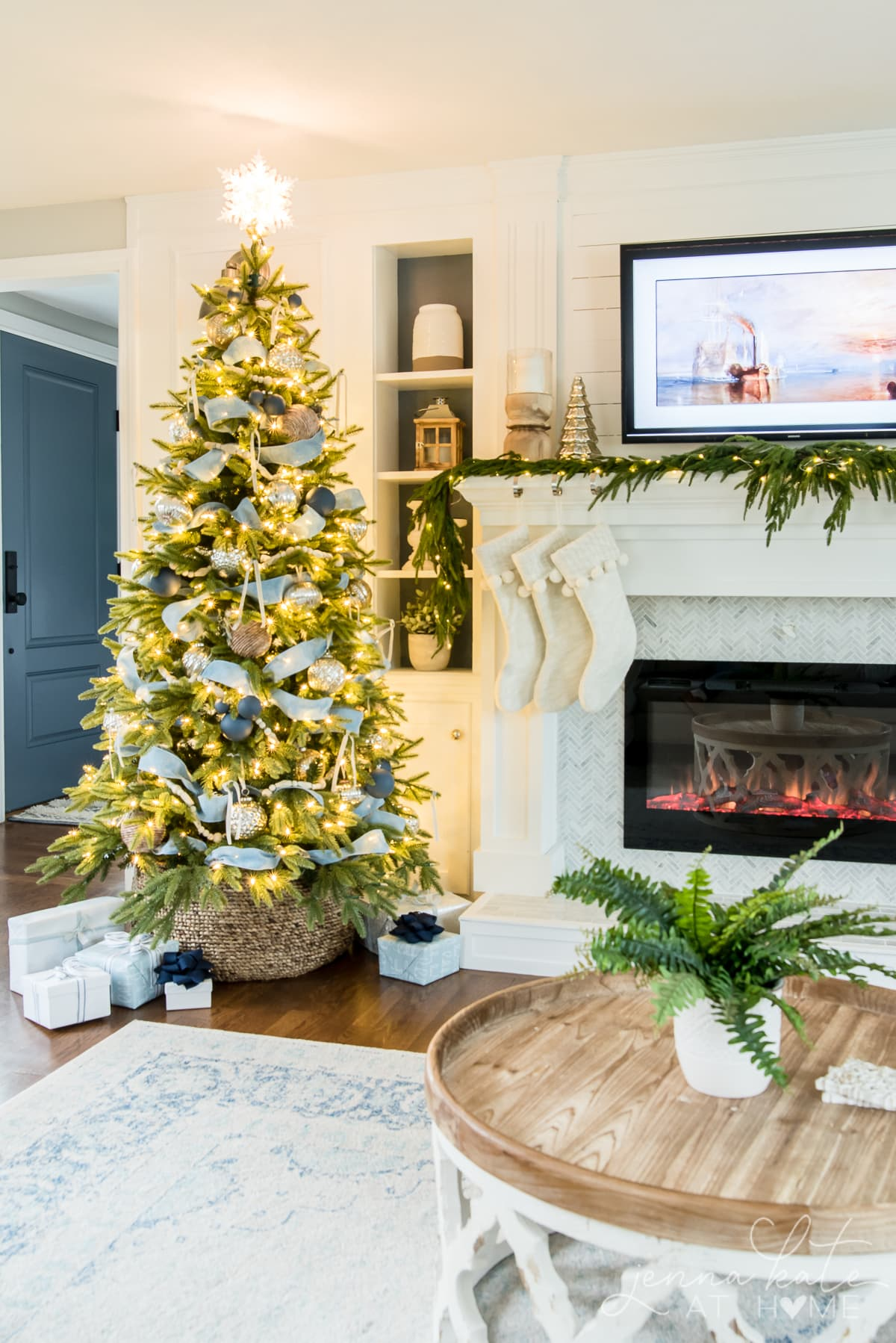 Christmas tree with different shades of blue and silver decor