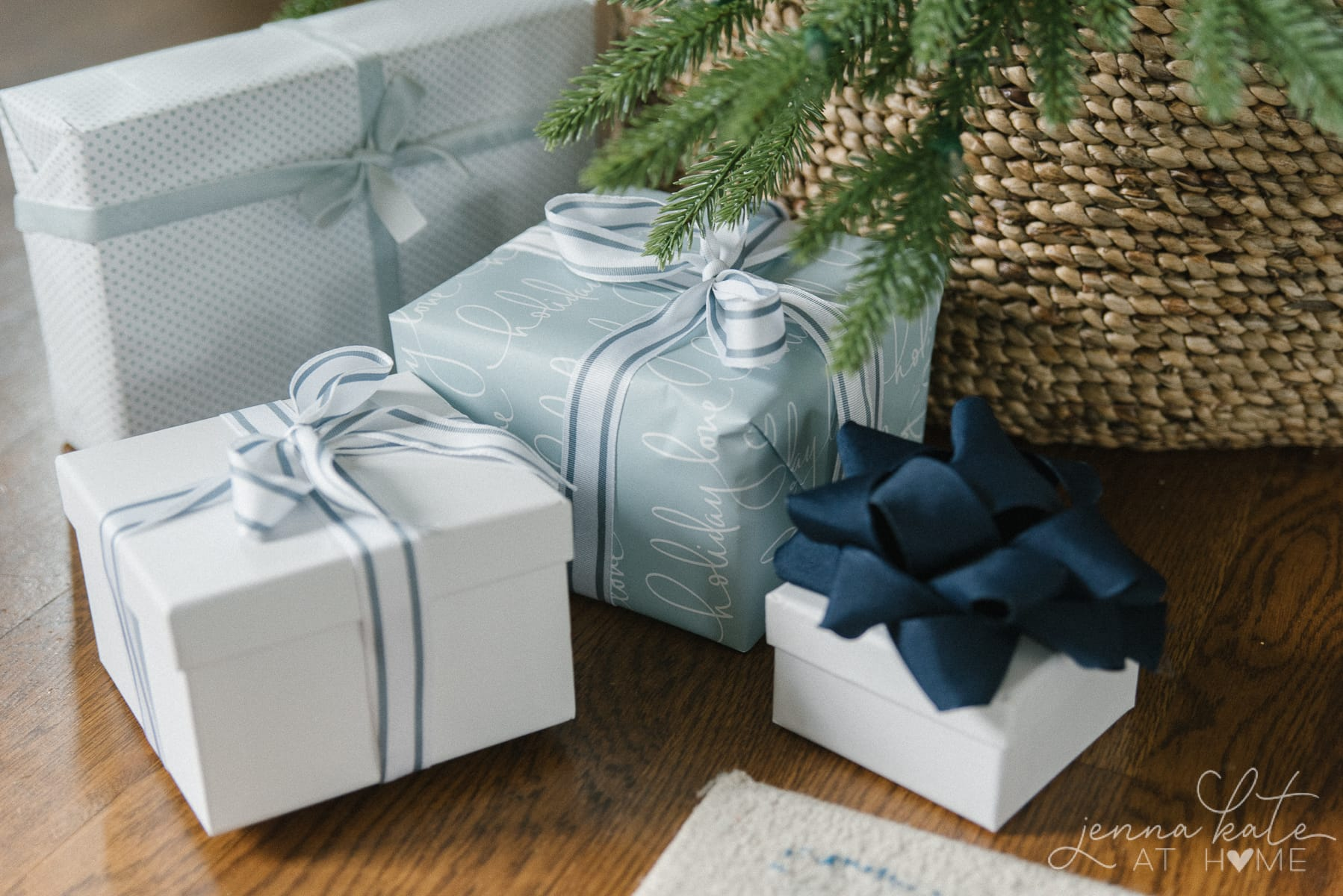 Different blue and silver wrapping paper and bows for the Christmas gifts