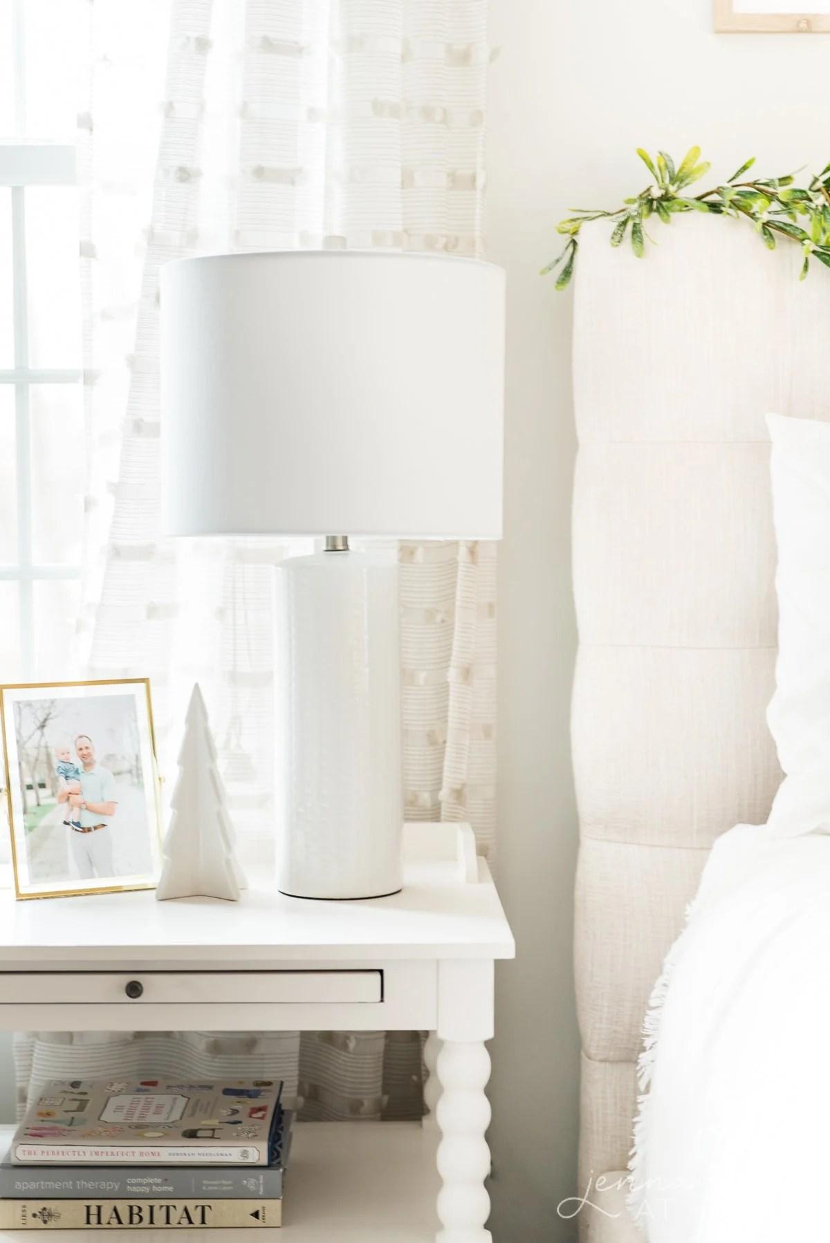 Simple white ceramic Christmas tree on the nightstand