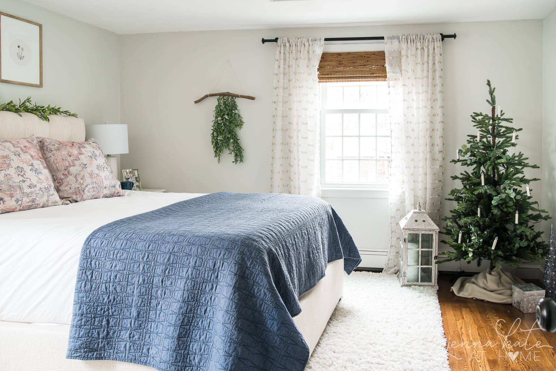 Bedroom with small Christmas tree in the corner