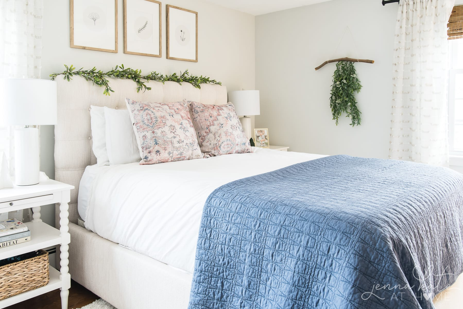Bedroom decorated for Christmas with blue duvet, and some simple greenery