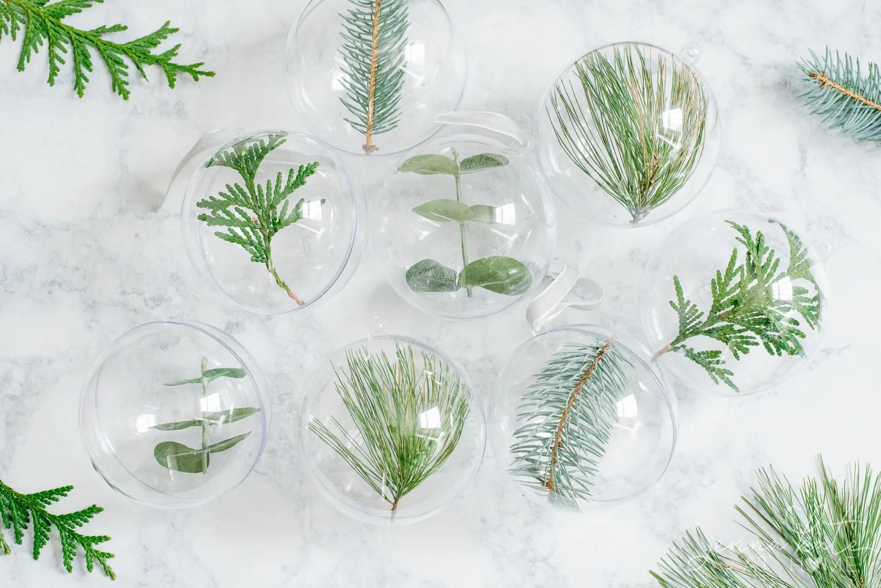 DIY minimalist Christmas tree ornaments filled with fresh greenery