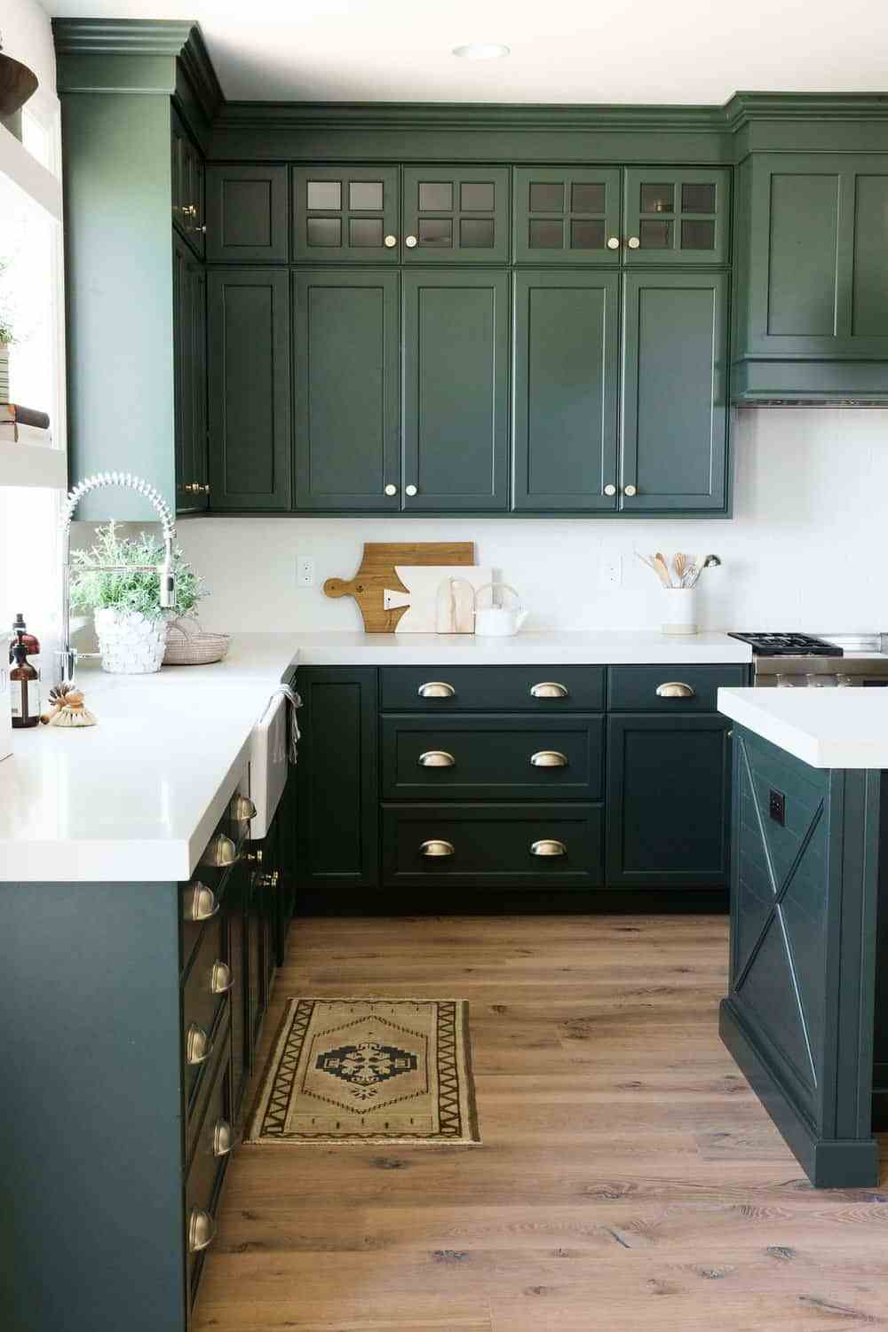 Glossy kitchen cabinets painted dark green color Dunn Edwards Black Spruce