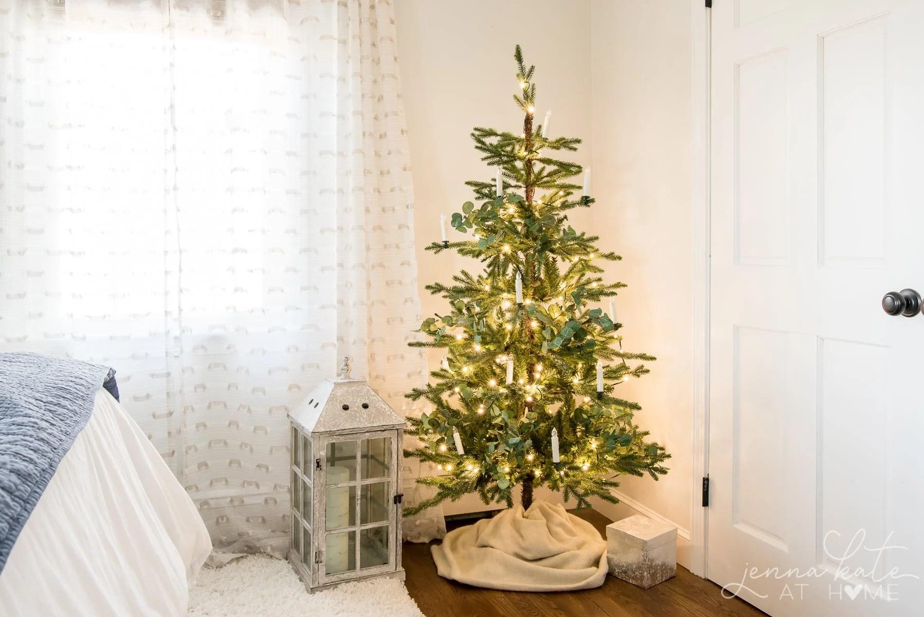 Minimalist, Scandinavian style Christmas tree in a bedroom