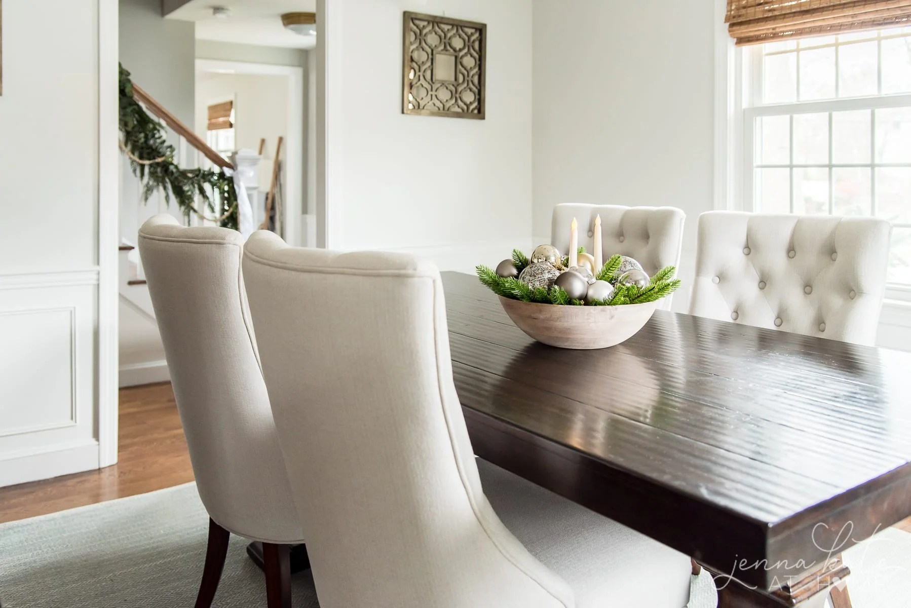 A living room filled with furniture and Christmas centerpiece on a table