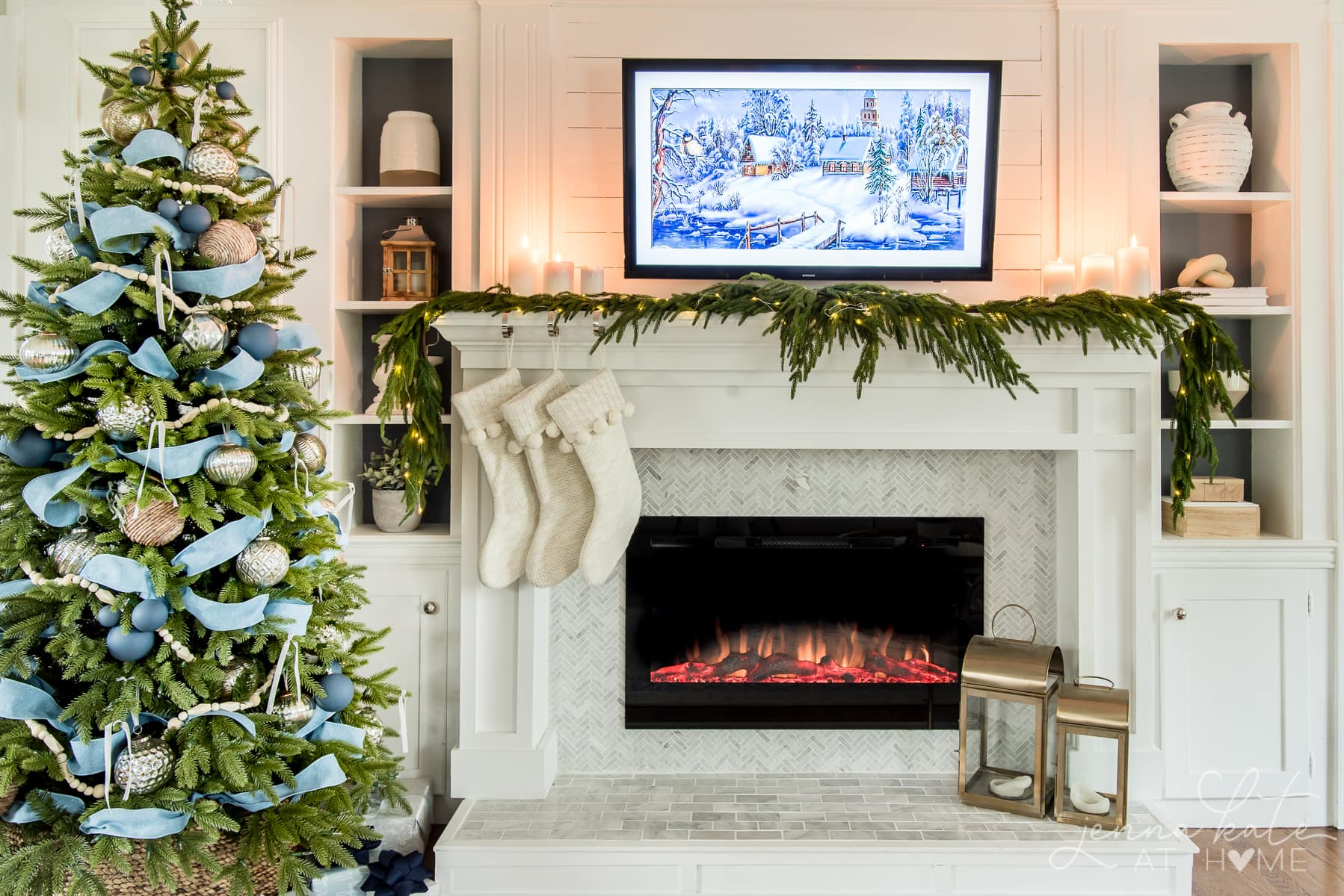 Living room fireplace and mantel with minimal garland and Christmas tree