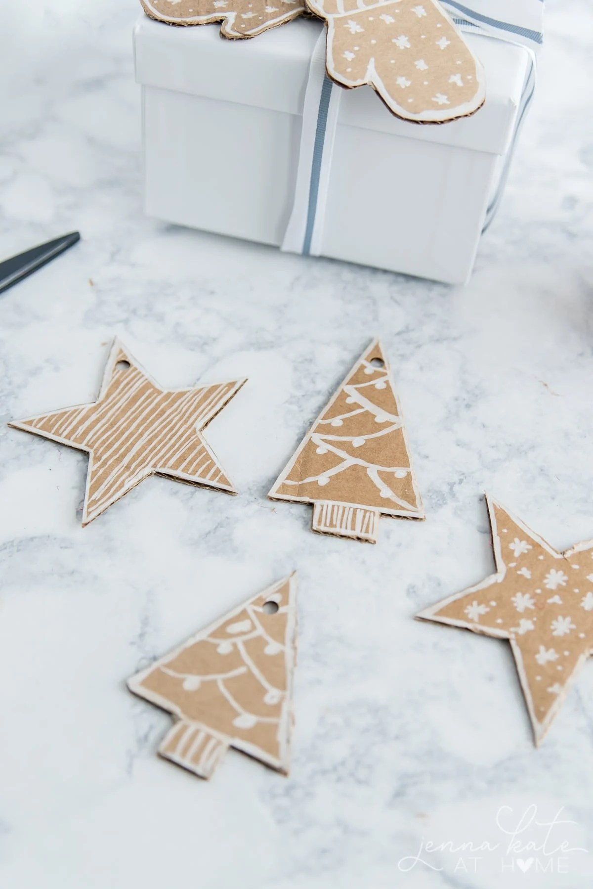 Christmas tree and star cut outs from cardboard for gift tags