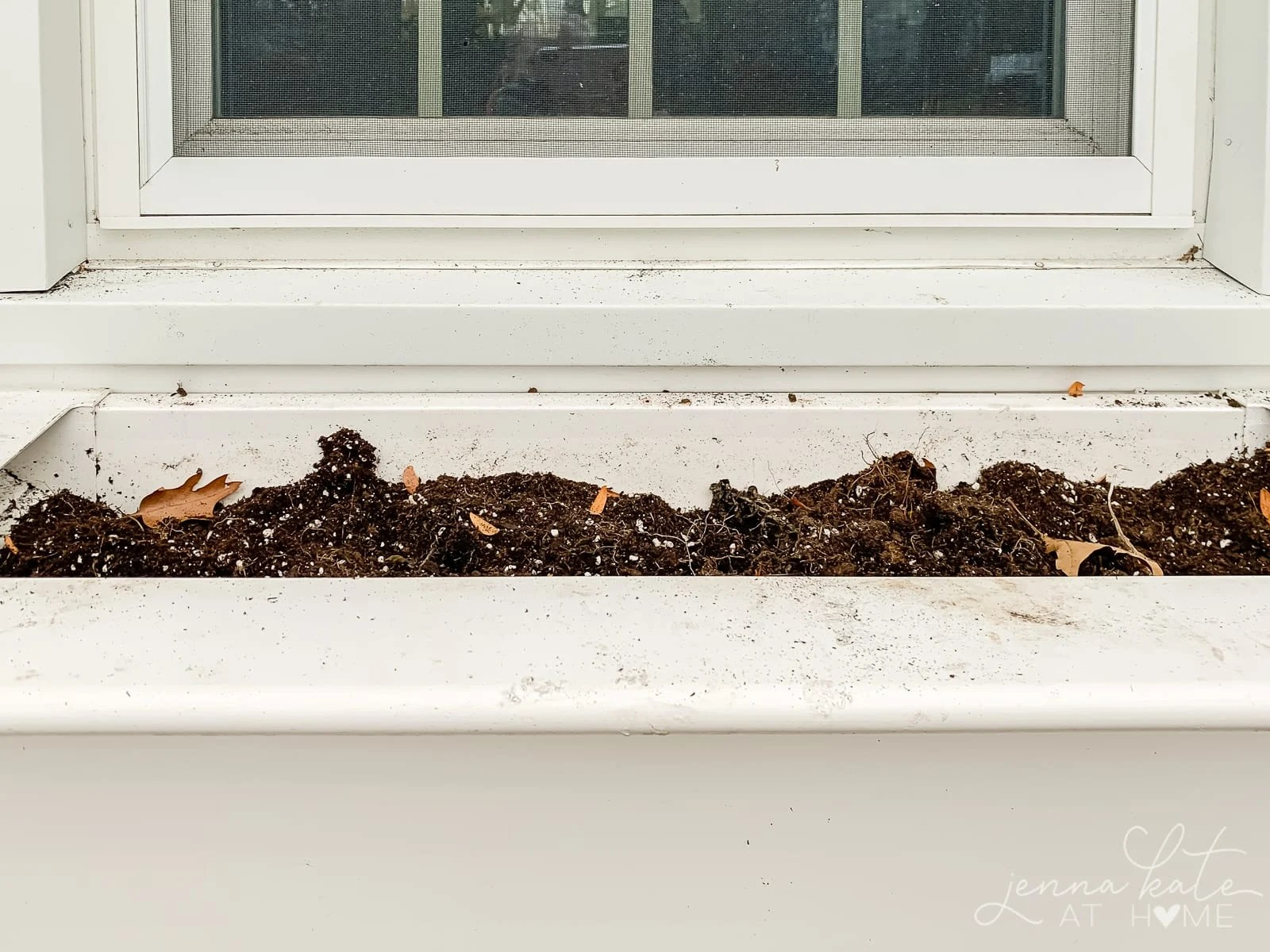 Window box with just dirt in it