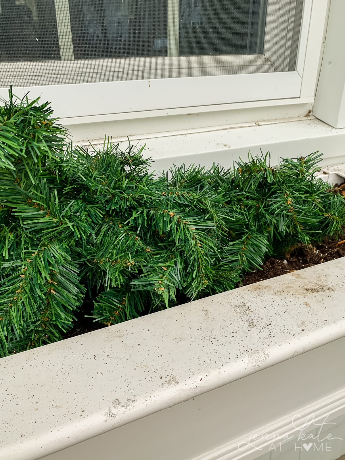 Artificial greenery to line the base of the window box