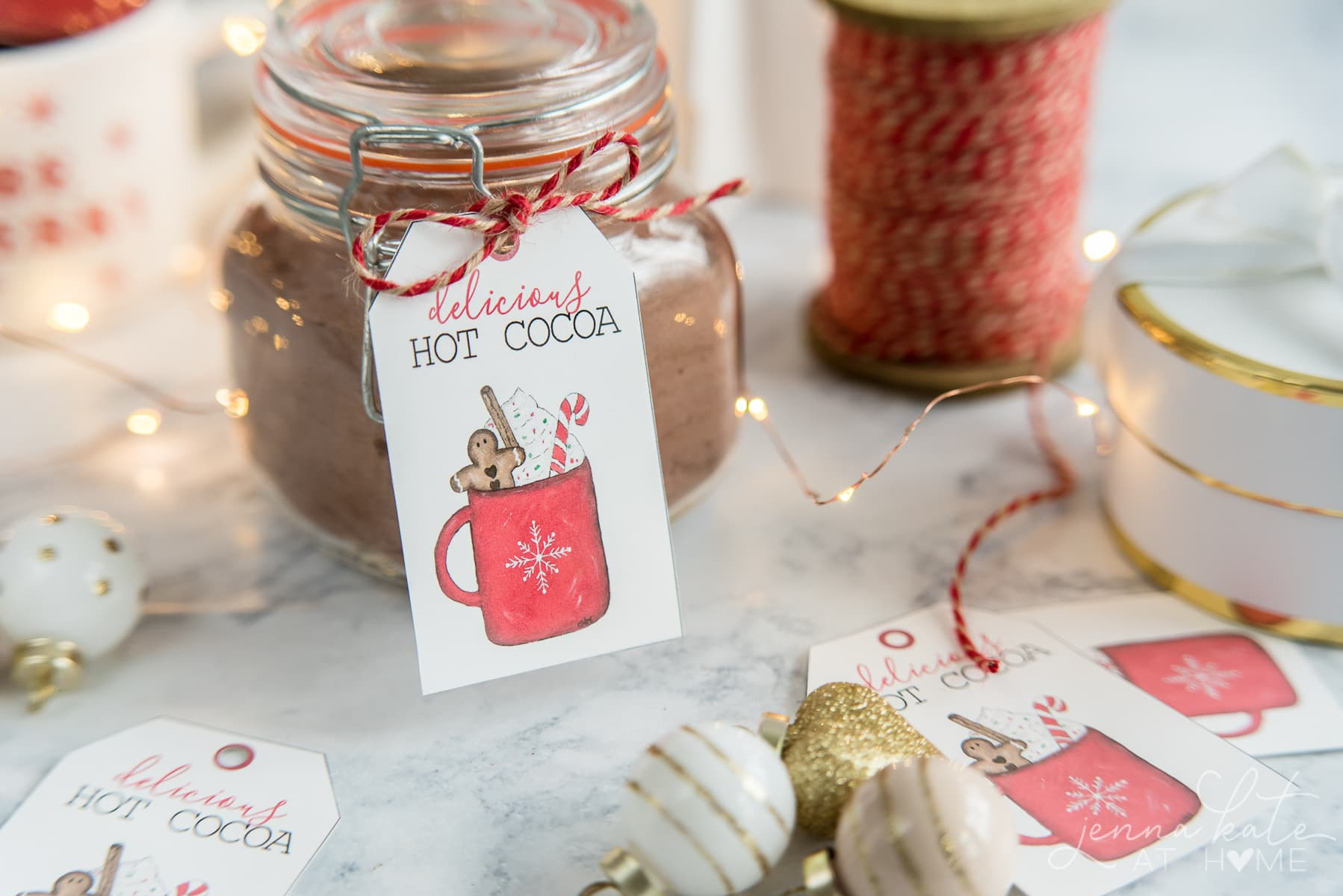 Making a basic glass jar look festive with a cute hot chocolate gift tag to download for free
