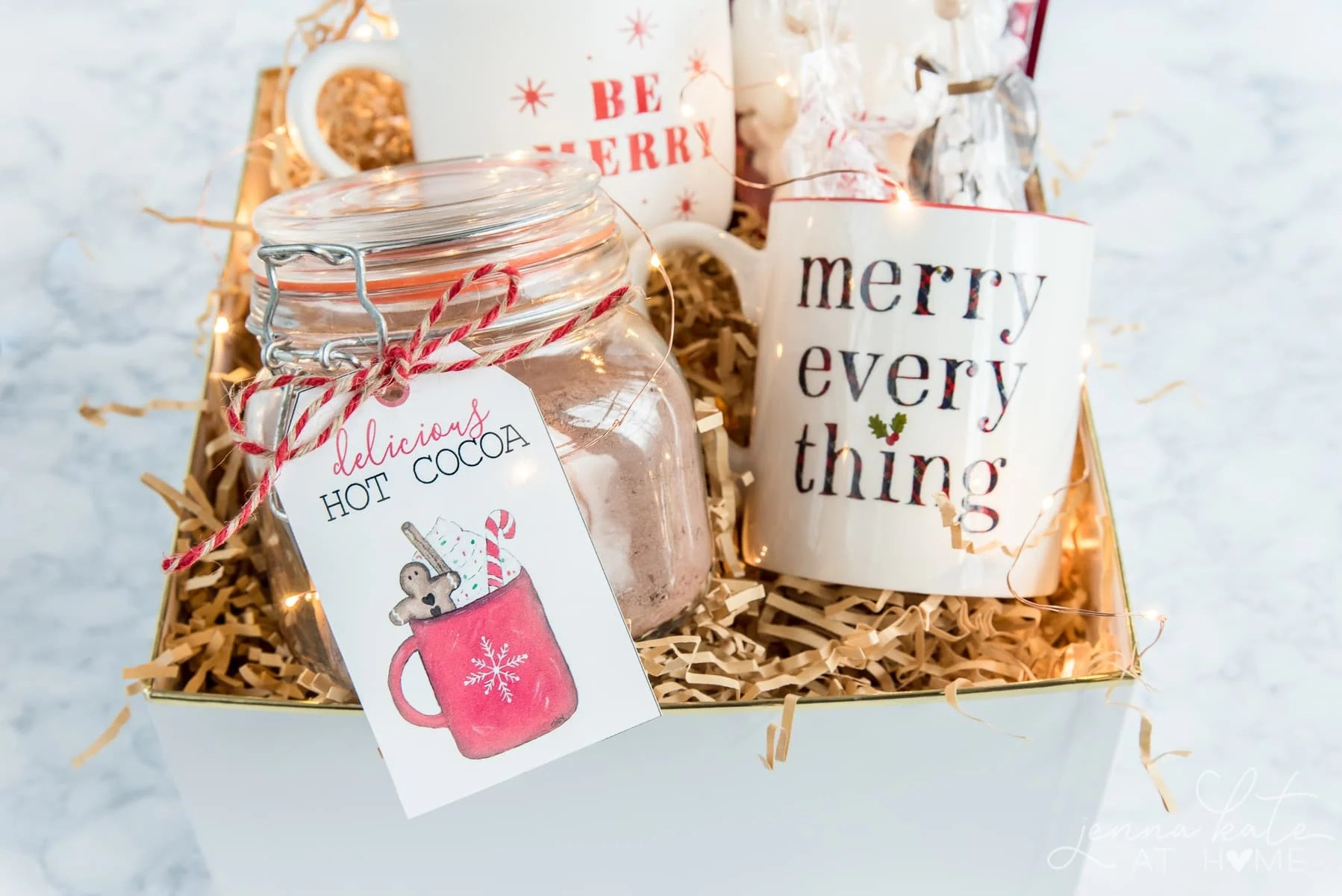 Hot chocolate gift basket idea with homemade mix, Christmas mugs, stir sticks and marshmallows