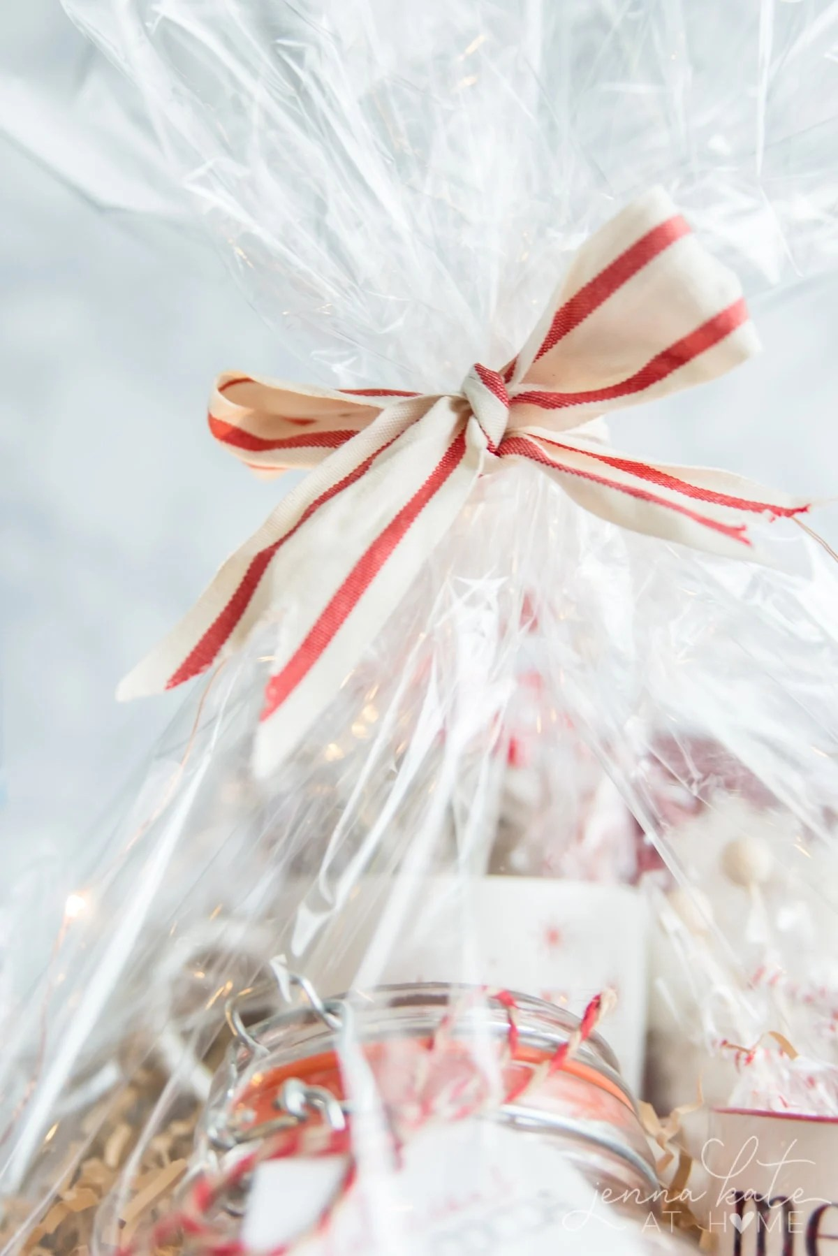 Gift basket wrapped with cellophane and tied with a festive ribbon