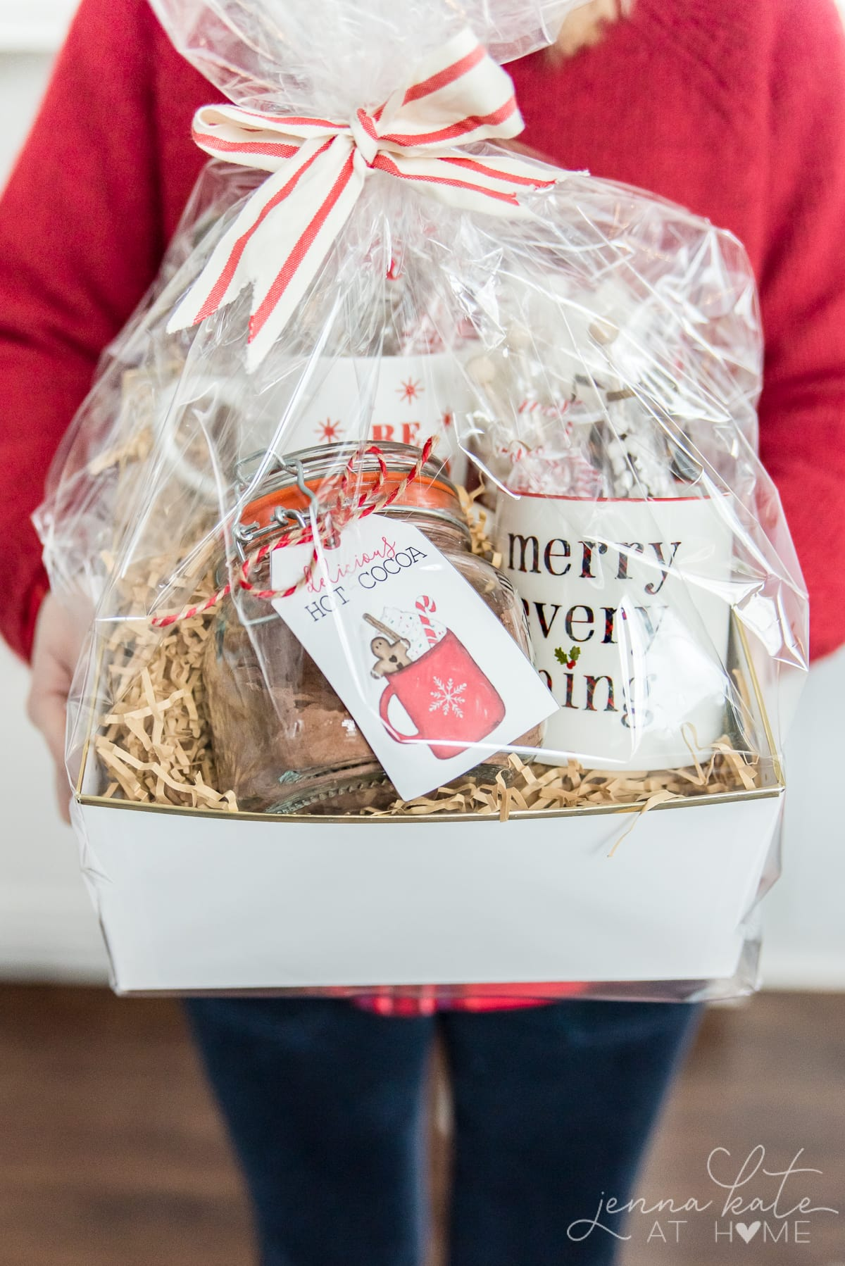 Woman holding the homemade hot chocolate mix gift basket